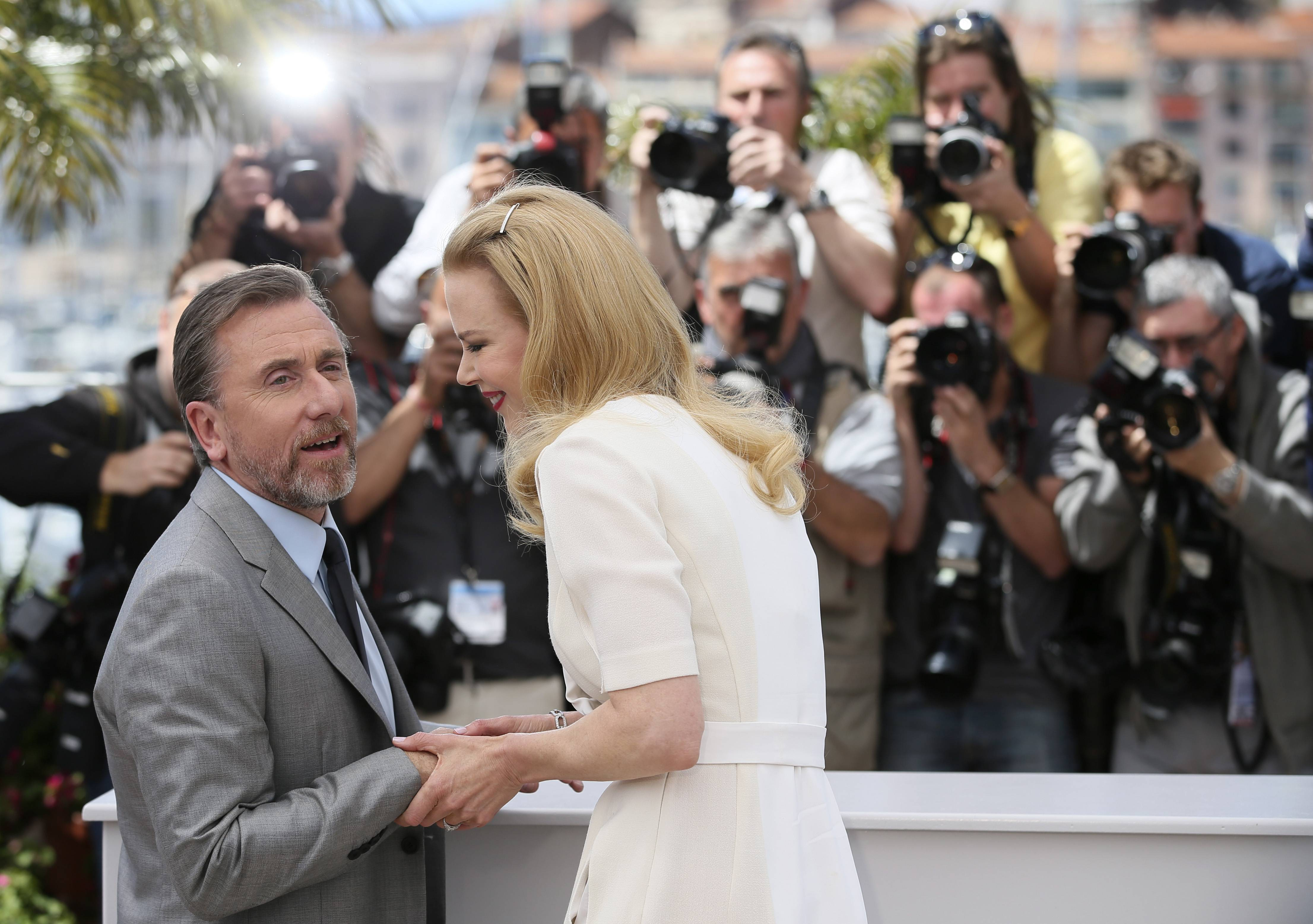 "Actress Nicole Kidman, right, and actor Tim Roth, left, pose for photographers during a photo call Wednesday for ""Grace of Monaco"" at the 67th Cannes Film Festival in southern France."
