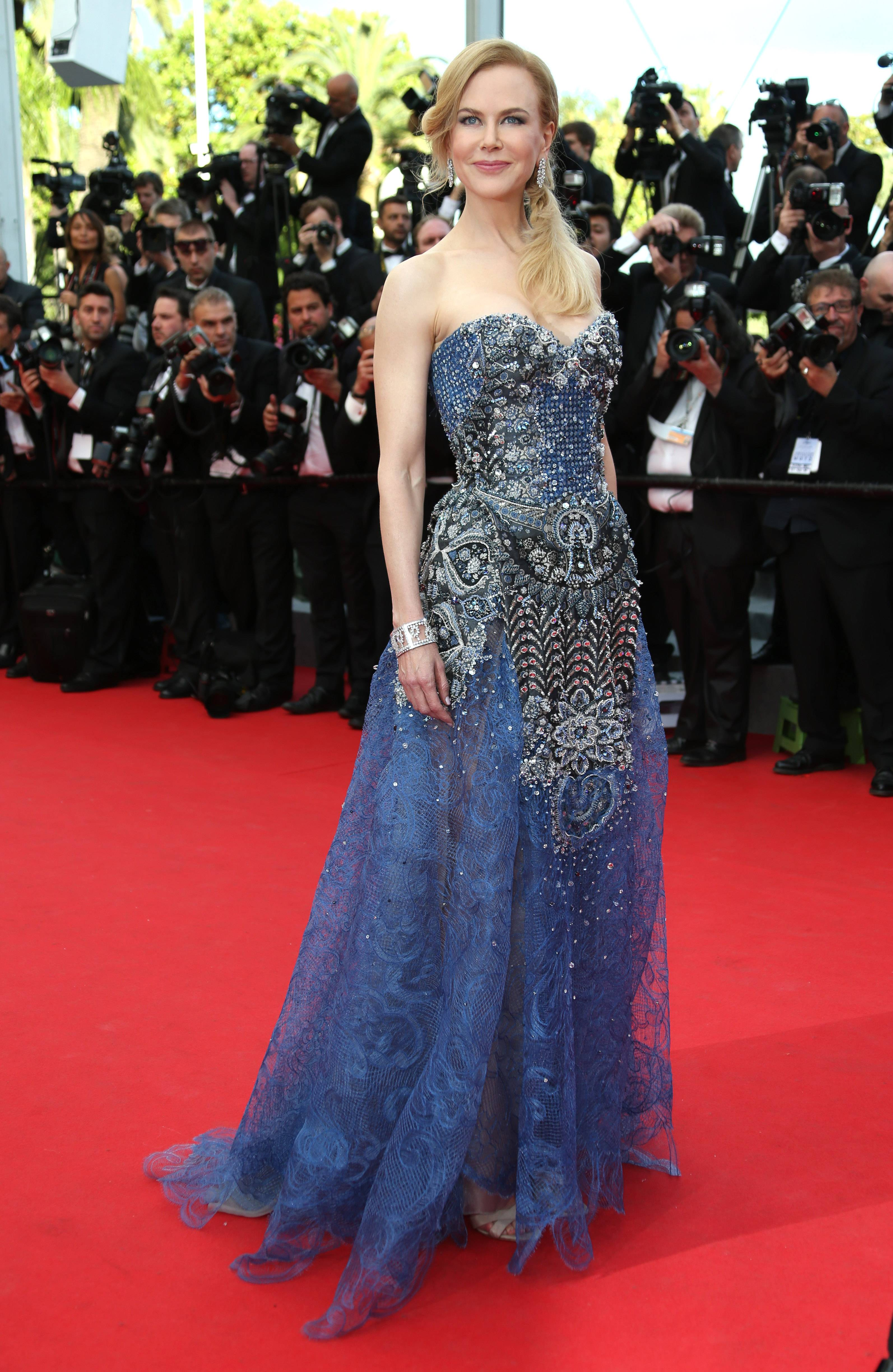"Actress Nicole Kidman poses for photographers Wednesday on the red carpet for the opening ceremony and the screening of ""Grace of Monaco"" at the 67th Cannes Film Festival in southern France."