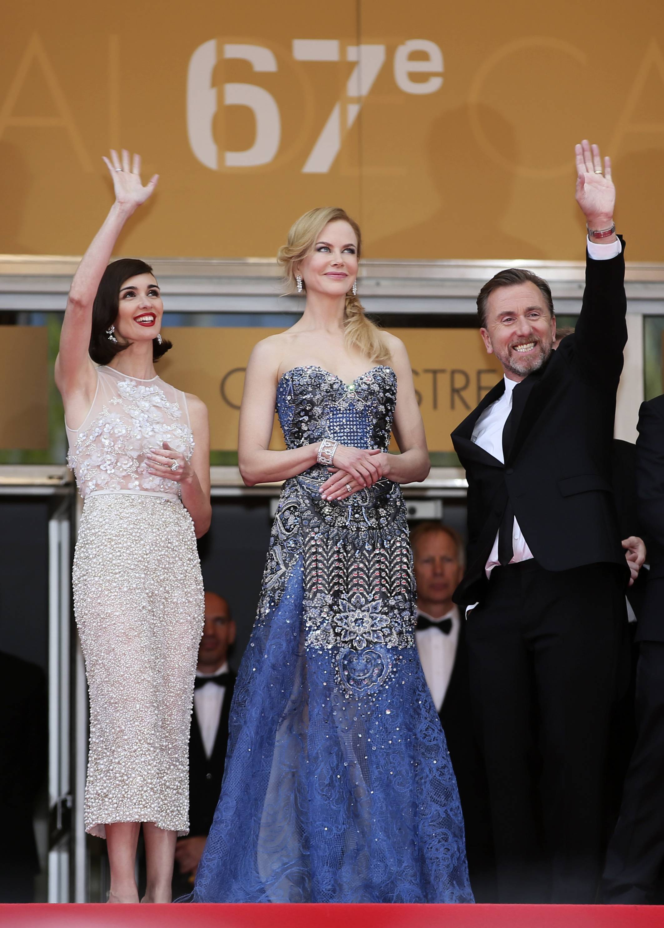 "From left, actress Paz Vega, actress Nicole Kidman and actor Tim Roth stand at the top of the steps as they arrive Wednesday for the opening ceremony and the screening of their film ""Grace of Monaco"" at the 67th Cannes Film Festival in southern France."