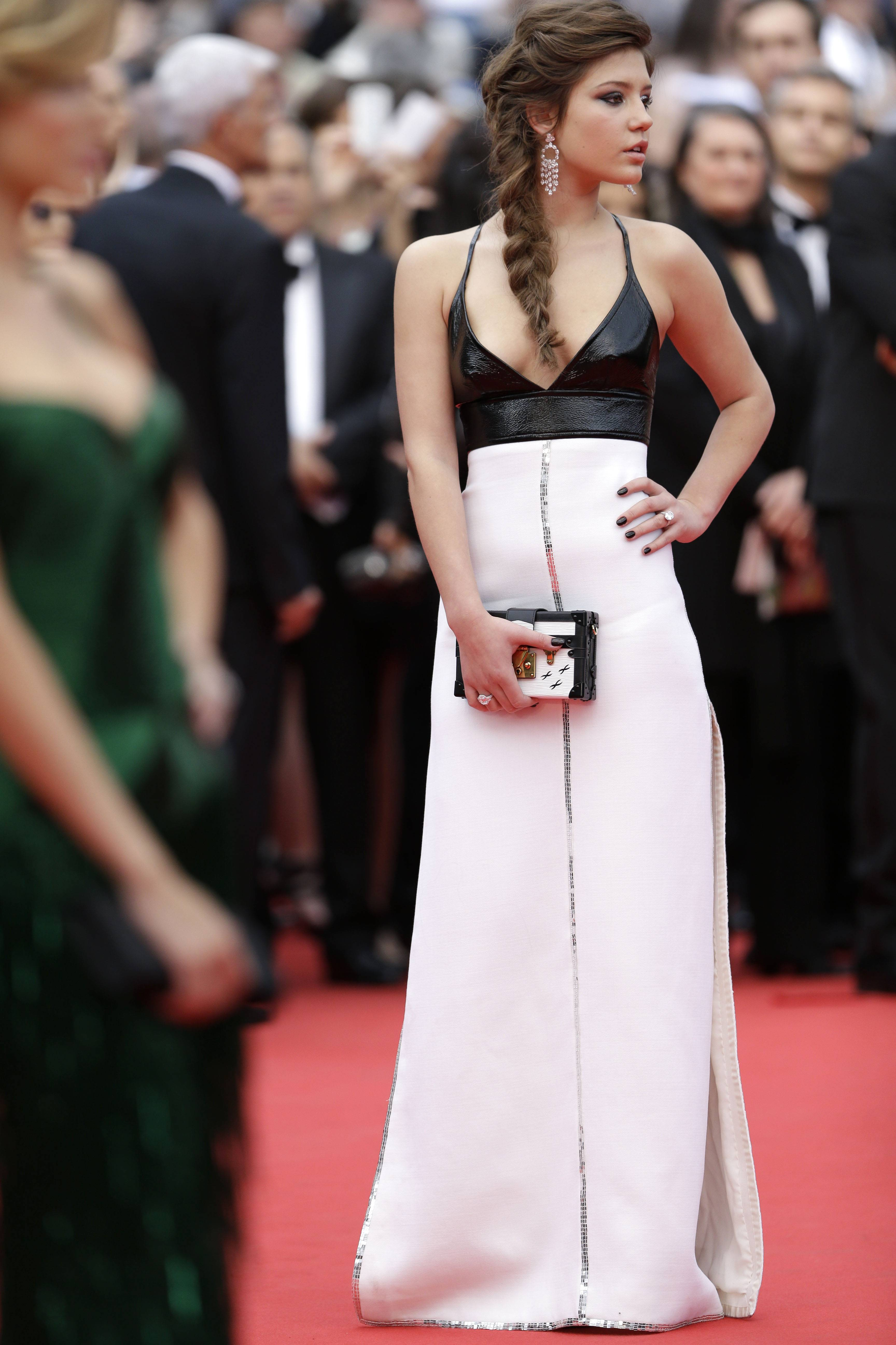 "Actress Adele Exarchopoulos poses for photographers as she arrives Wednesday for the opening ceremony and the screening of ""Grace of Monaco"" at the 67th Cannes Film Festival in southern France."