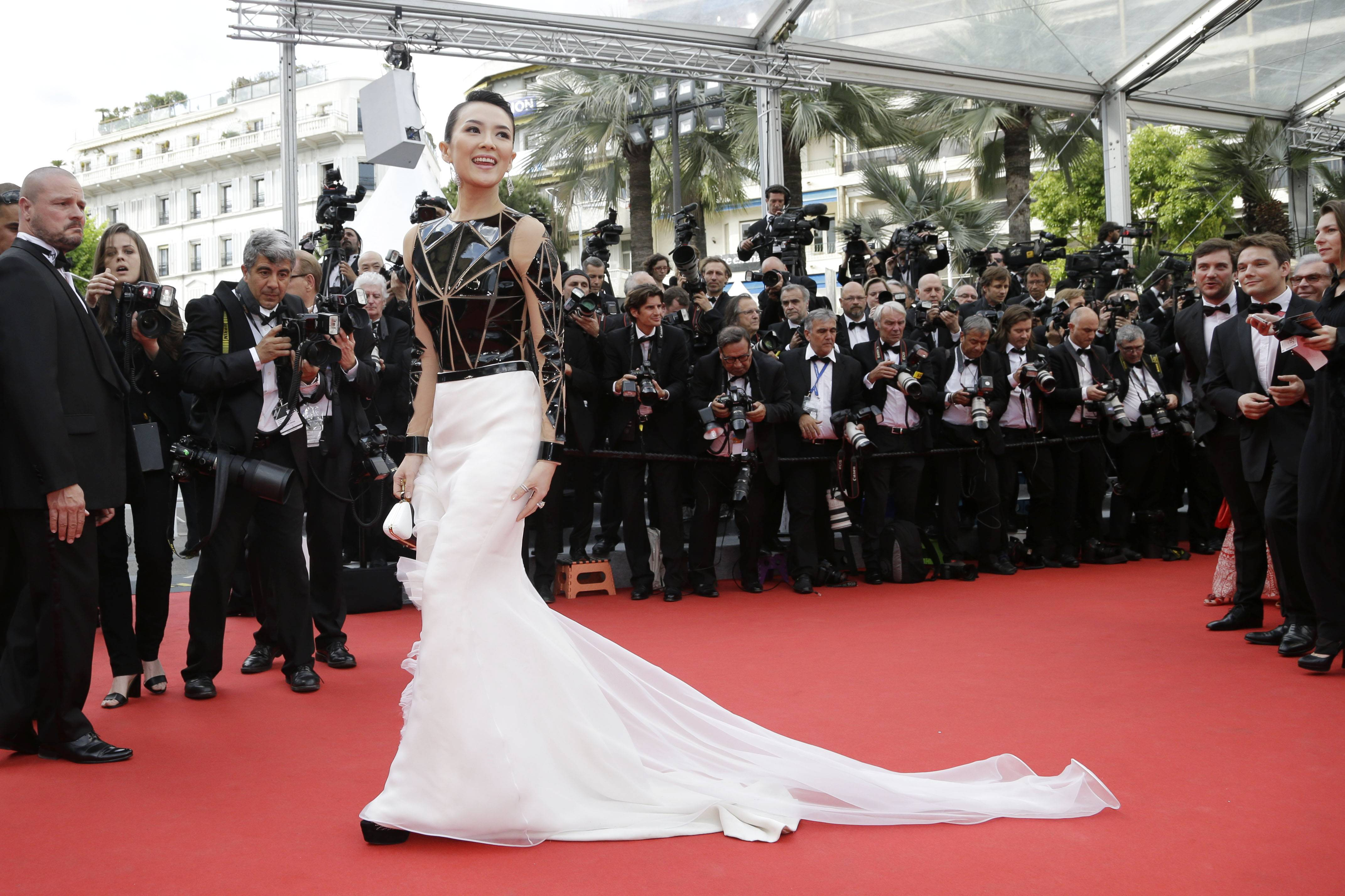 "Zhang Ziyi poses for photographers as she arrives Wednesday for the opening ceremony and the screening of ""Grace of Monaco"" at the 67th Cannes Film Festival in southern France."
