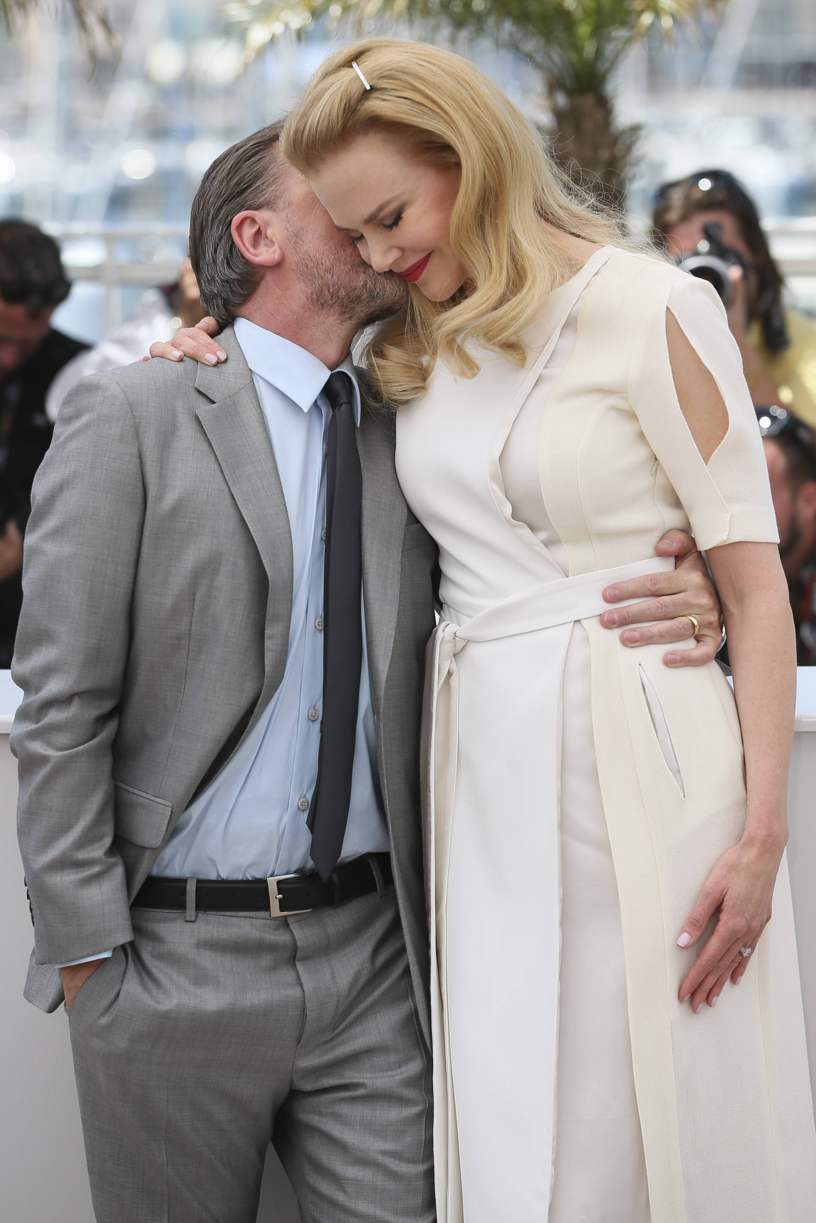 "Actor Tim Roth, left, kisses actress Nicole Kidman as they pose for photographers during a photo call Wednesday for ""Grace of Monaco"" at the 67th Cannes Film Festival in southern France."