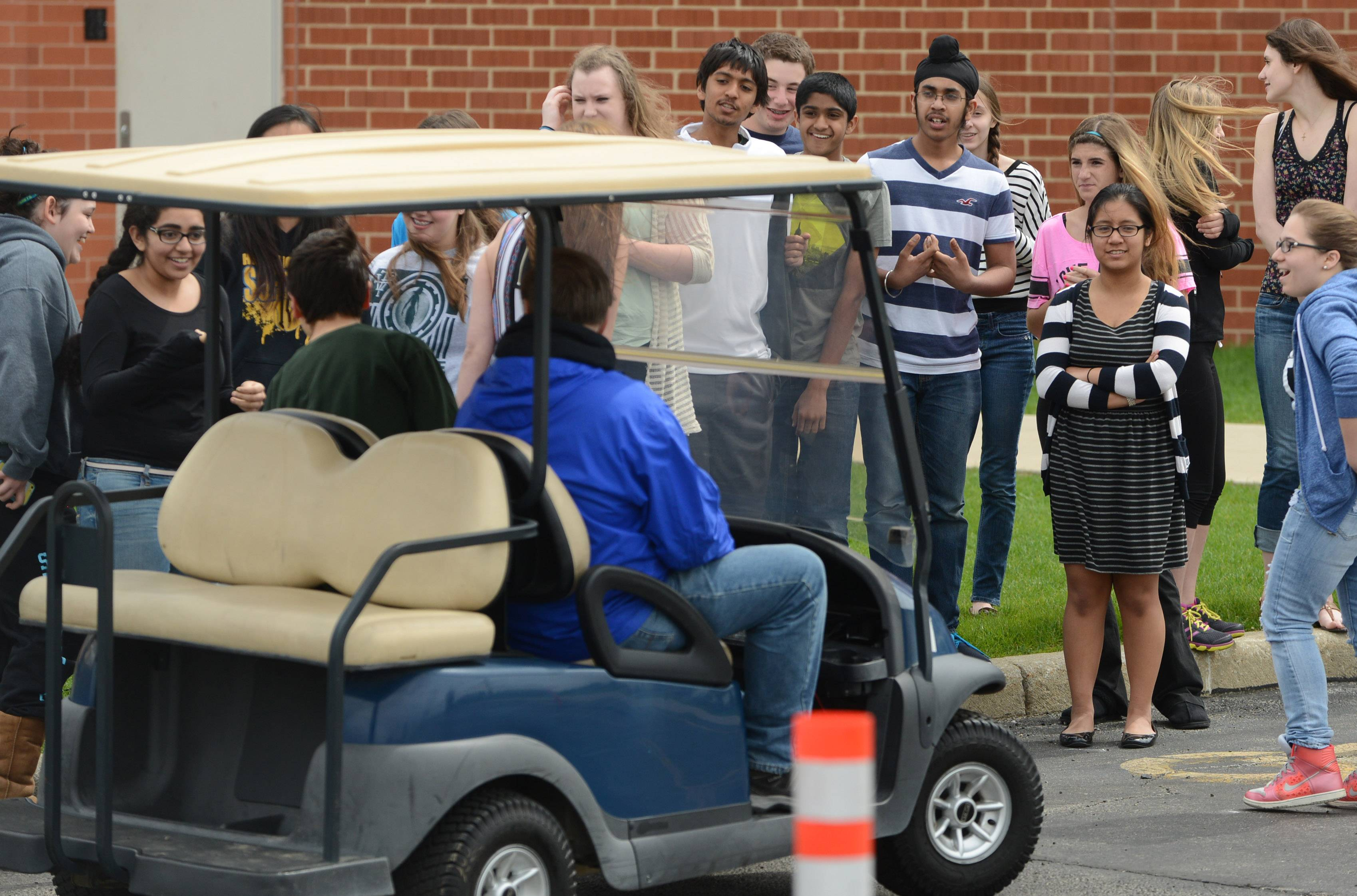 Students at Vernon Hills High School participated in a prom week obstacle course activity wearing special goggles simulating drunken driving on Wednesday.