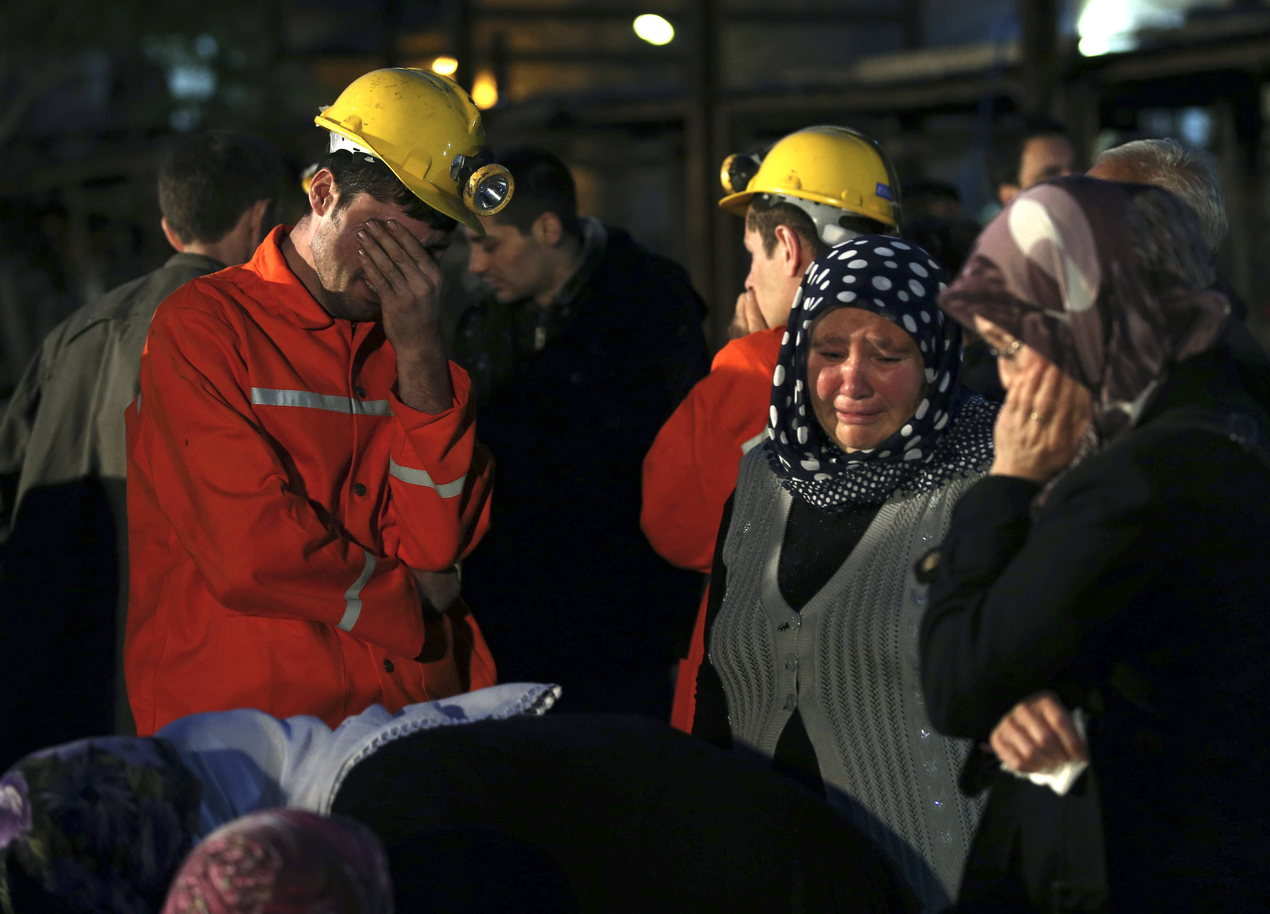 Miners and family members wait outside a coal mine following an explosion in Soma, western Turkey, Wednesday.