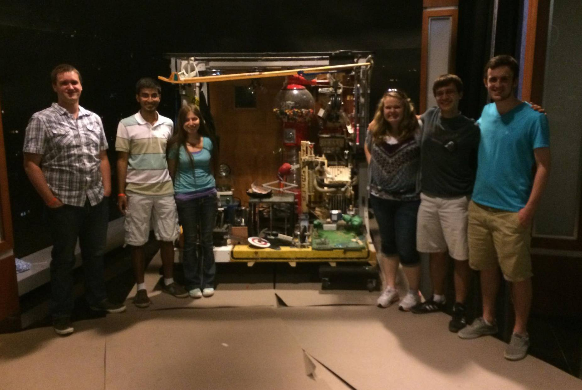 "Adam Bahrainwala (second from left) and his engineering team stand next to their award-winning Rube Goldberg Machine on the ""Jimmy Kimmel Live!"" stage at the El Captain Theater in Hollywood. The team will show off the machine Wednesday night on the Kimmel show. From left to right, David Cannon of Valparaiso, Ind.; Bahrainwala, of Palatine; Jordan Vallejo of Los Angeles; Rebecca Russell of Elkhorn, Wis.; Benjamin Hilker of Edwardsville, Ill.; and Andrew Rawlins of Greenwood, Ind."