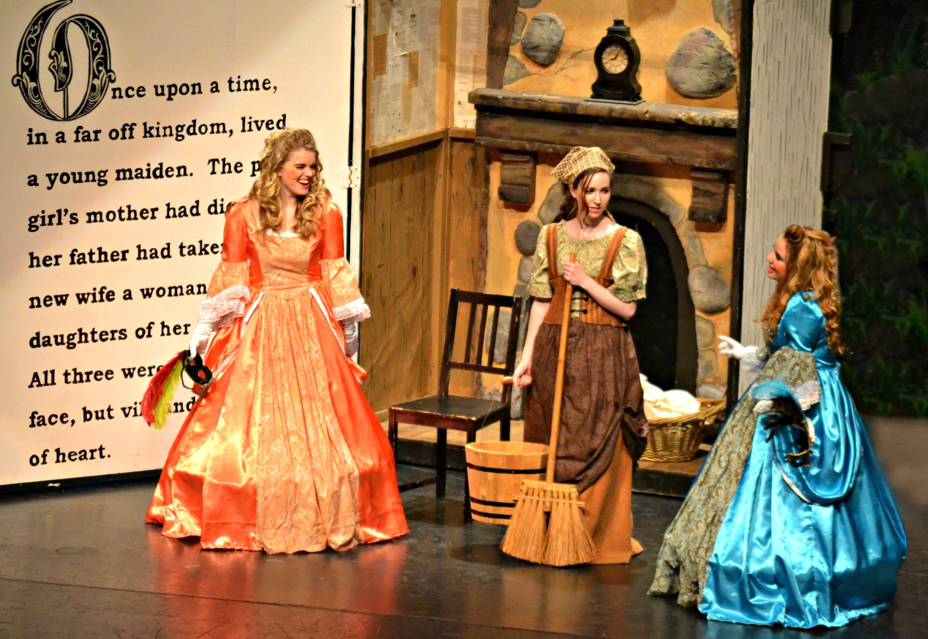 "Cinderella, played by Sydney Rae Trotter, and her stepsisters, played by Nicole Frantik, right, and Savannah Fiedler, rehearse a scene from ""Grimm Fairy Tales."""