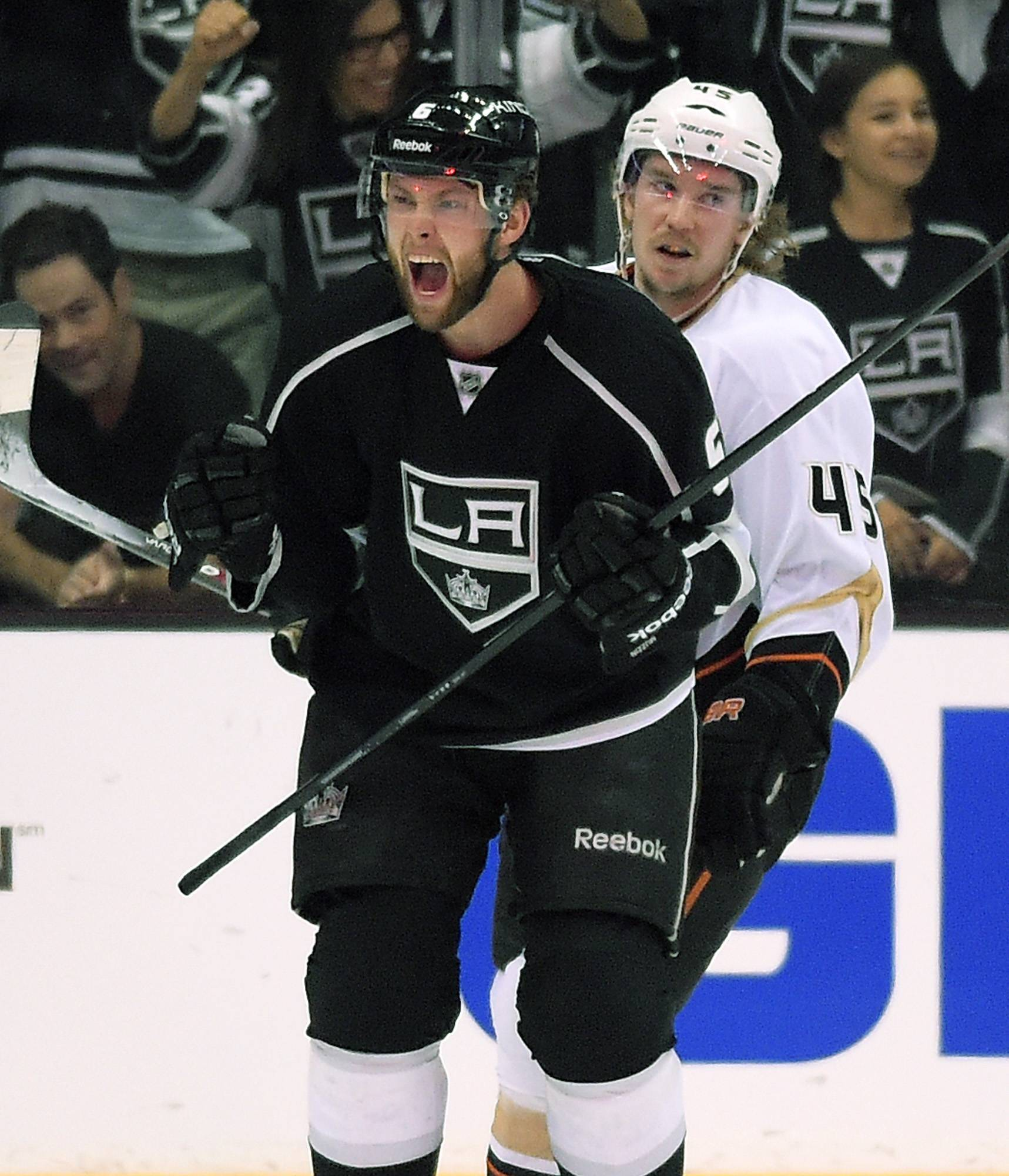 Los Angeles Kings defenseman Jake Muzzin, left, celebrates his goal as Anaheim Ducks left wing Patrick Maroon looks on during the first period in Game 6 of an NHL hockey second-round Stanley Cup playoff series, Wednesday, May 14, 2014, in Los Angeles.