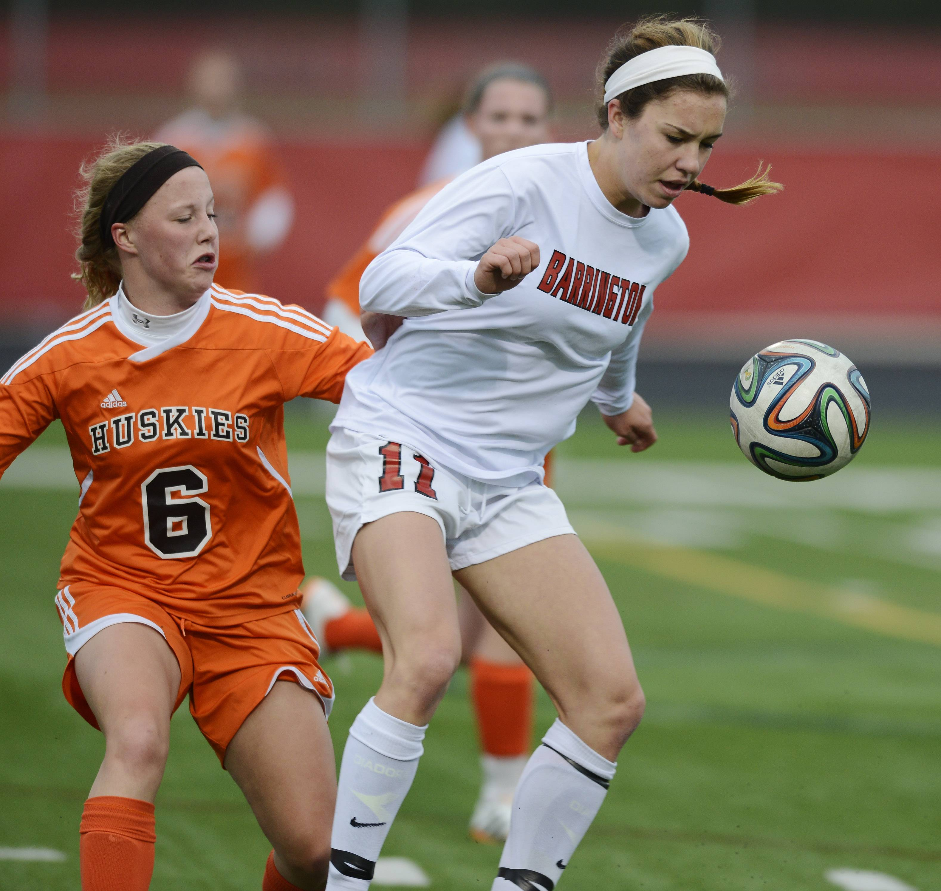 Barrington's Jenna Szczesny gets between the ball and Hersey's Sara Magnuson during the Mid-Suburban League championship game at Barrington on Wednesday.