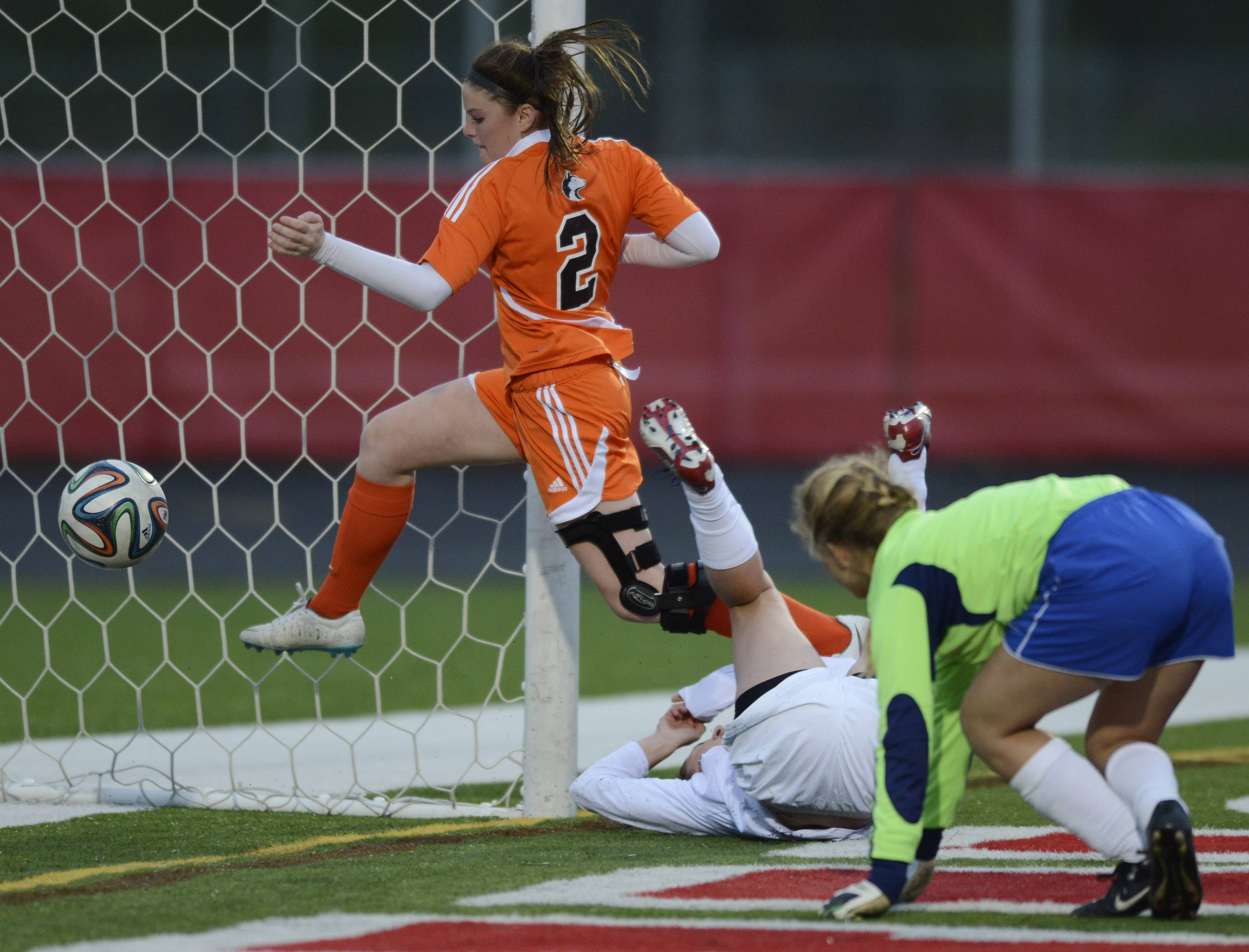 Hersey's Megan Brant, left, is unable to keep the ball from crossing the goal line on a shot by Barrington's Maesyn Poidomani as Hersey goalkeeper Morgan Harris tries to get back into position during the Mid-Suburban League championship game at Barrington on Wednesday.