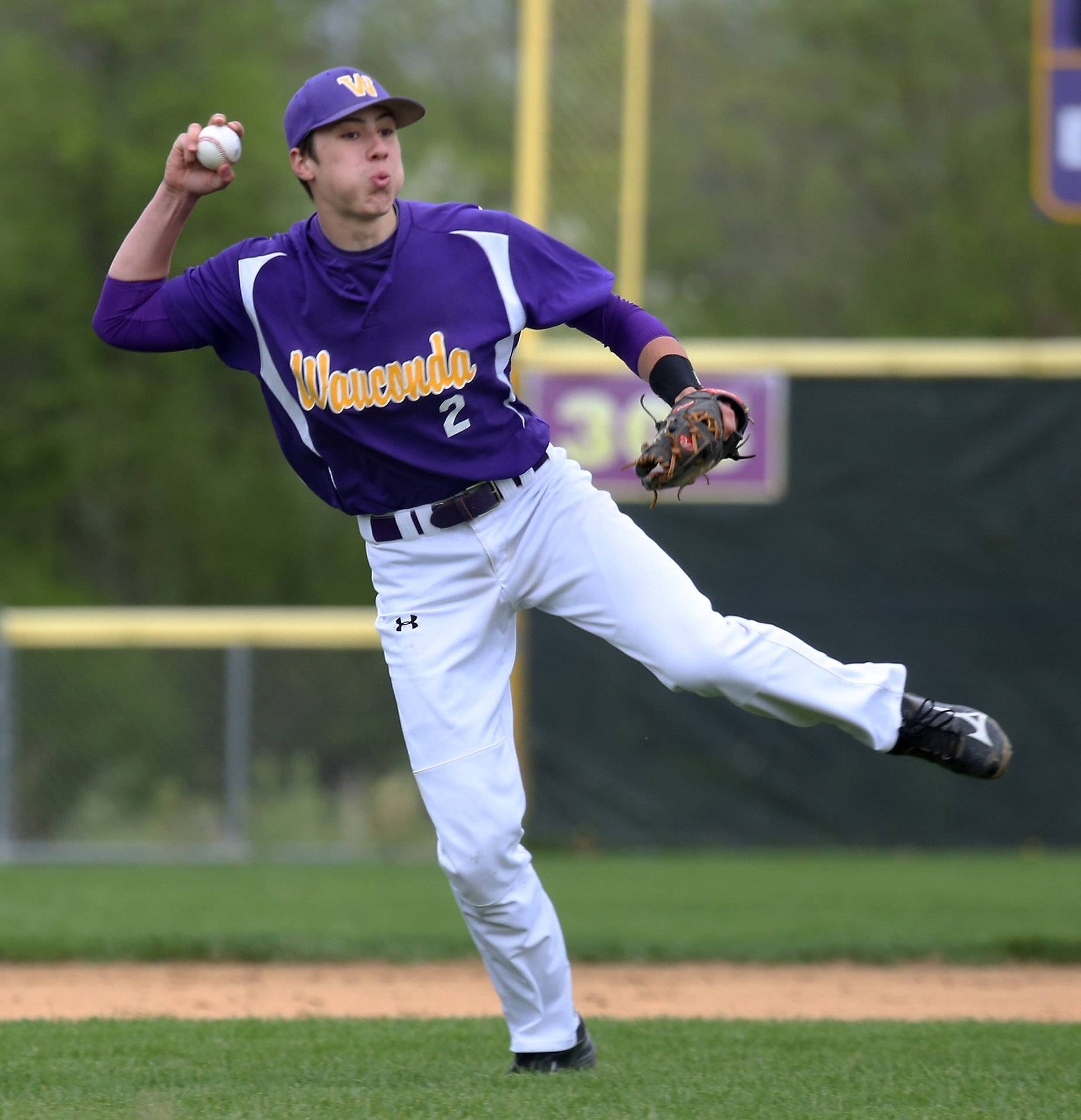 Wauconda shortstop Jake Grobelny scoops up a groundball before throwing to first base Wednesday against visiting Lakes.
