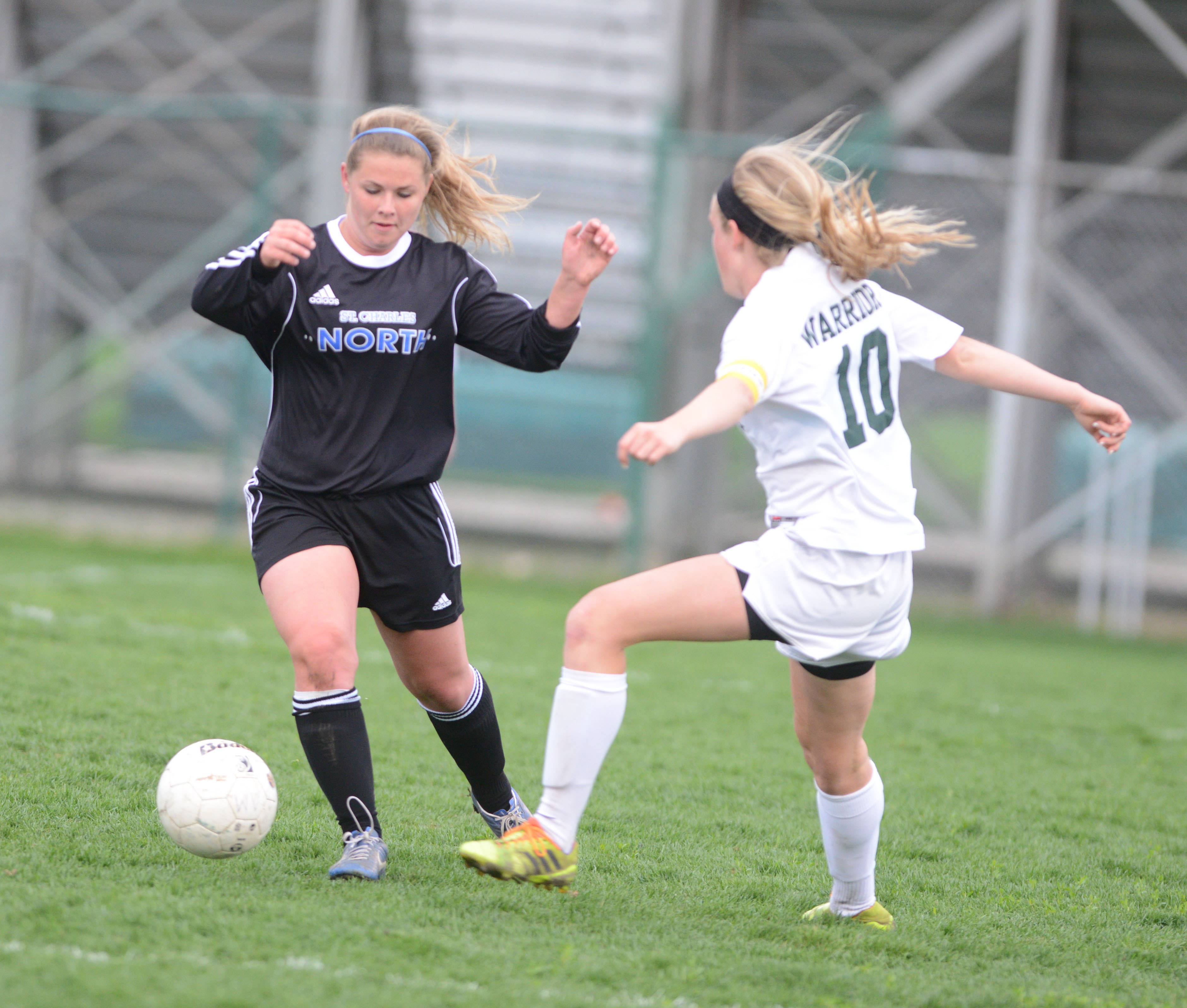 Natalie Winkates of Saint Charles North and MacKenzie Fuller of Waubonsie take control of the ball during the  St. Charles North at Waubonsie Valley girls soccer game Wednesday.