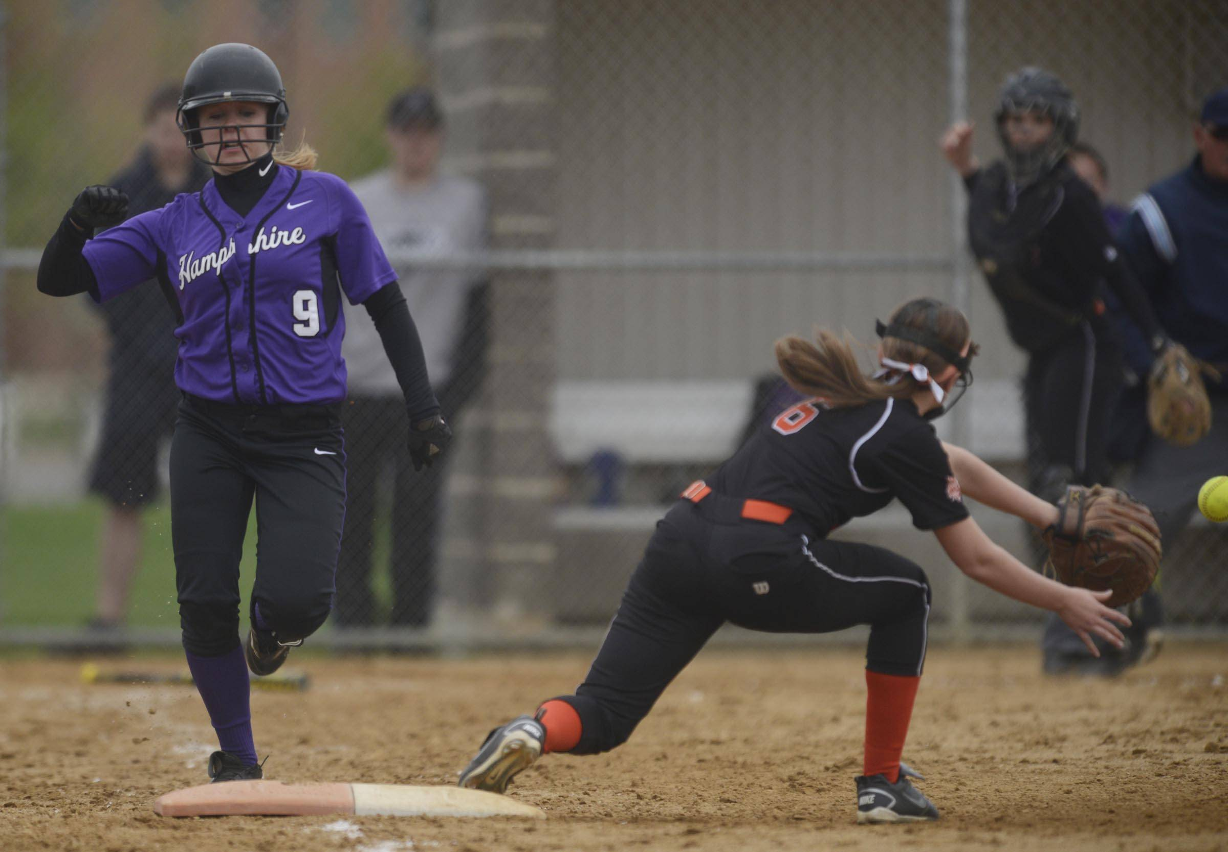 Hampshire's Erin Doyle scrambles down the first base line to beat the throw to Crystal Lake Central's Rachel Kautz in the sixth inning Wednesday in Hampshire.