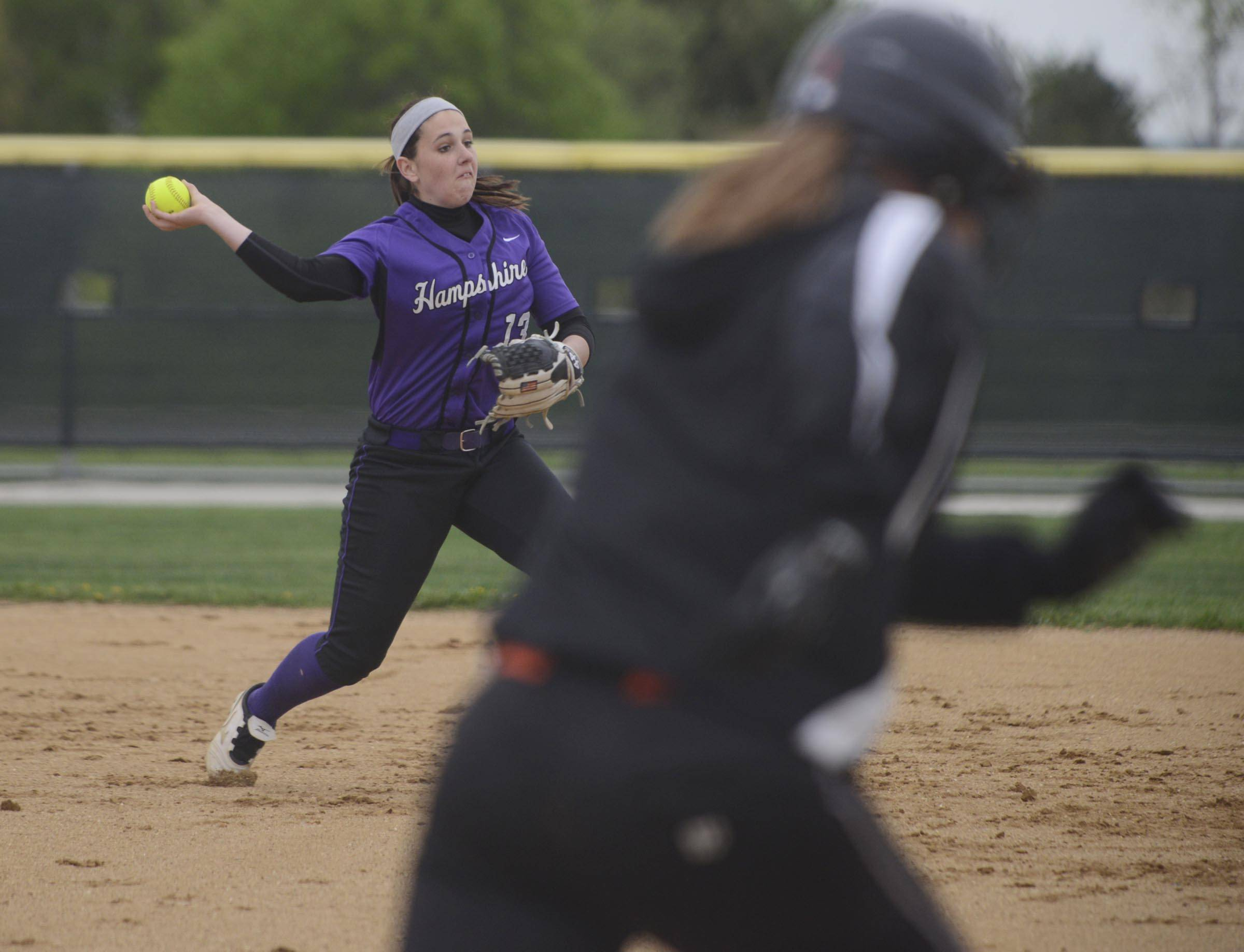 Hampshire's Peyton DeChant throws out a Crystal Lake Central runner in the first inning Wednesday in Hampshire.