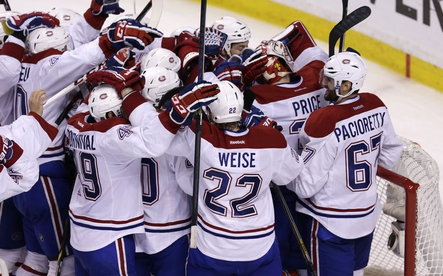 7a87ed3b230 Montreal Canadiens goalie Carey Price is congratulated by teammates after  the Canadiens' 3-1