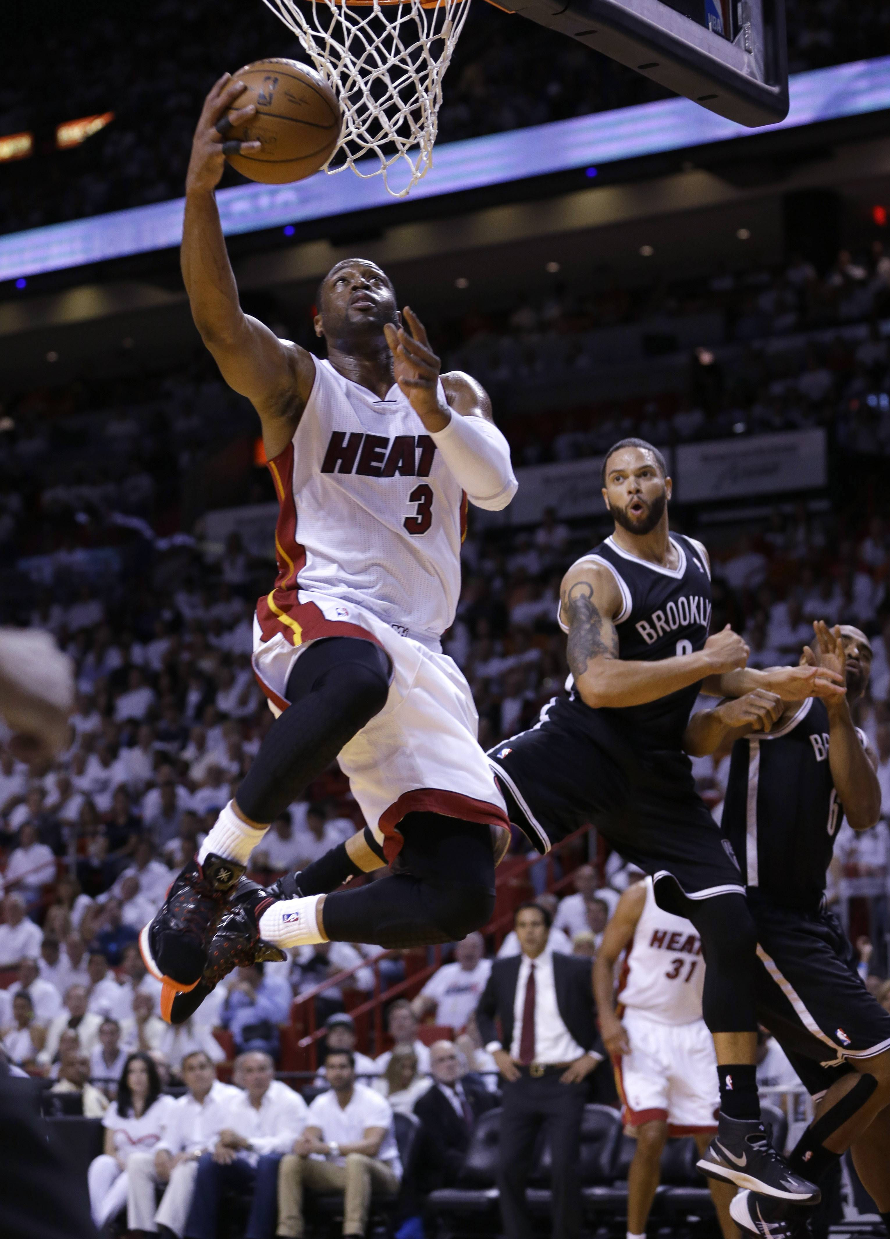 Miami Heat guard Dwyane Wade (3) goes to th basket against the Brooklyn Nets during the first half of Game 5 of a second-round NBA playoff basketball game in Miami, Wednesday, May 14, 2014.