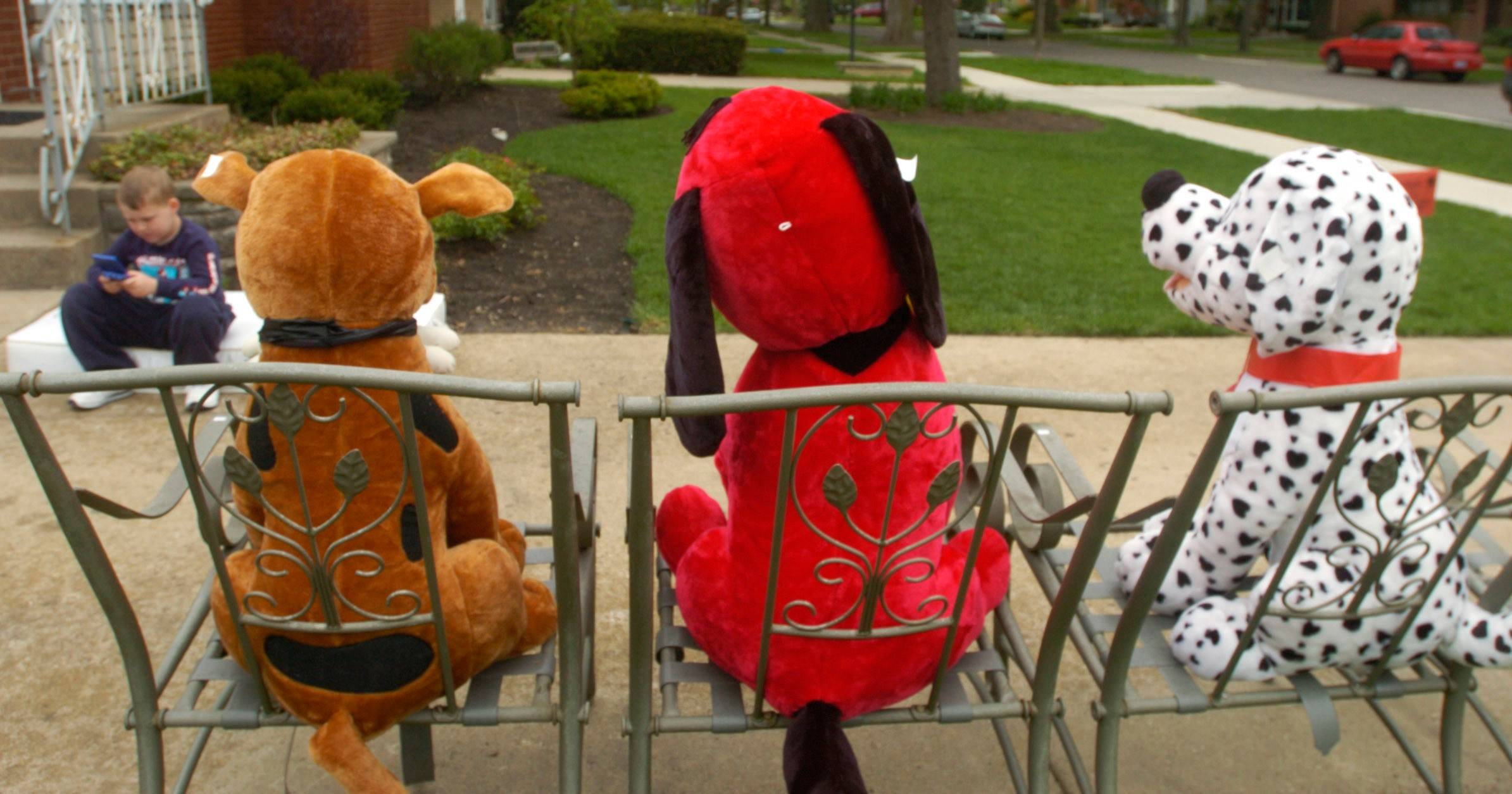 Stuffed animals are lined up on North Prospect Manor, ready to greet customers during a prior villagewide garage sale.