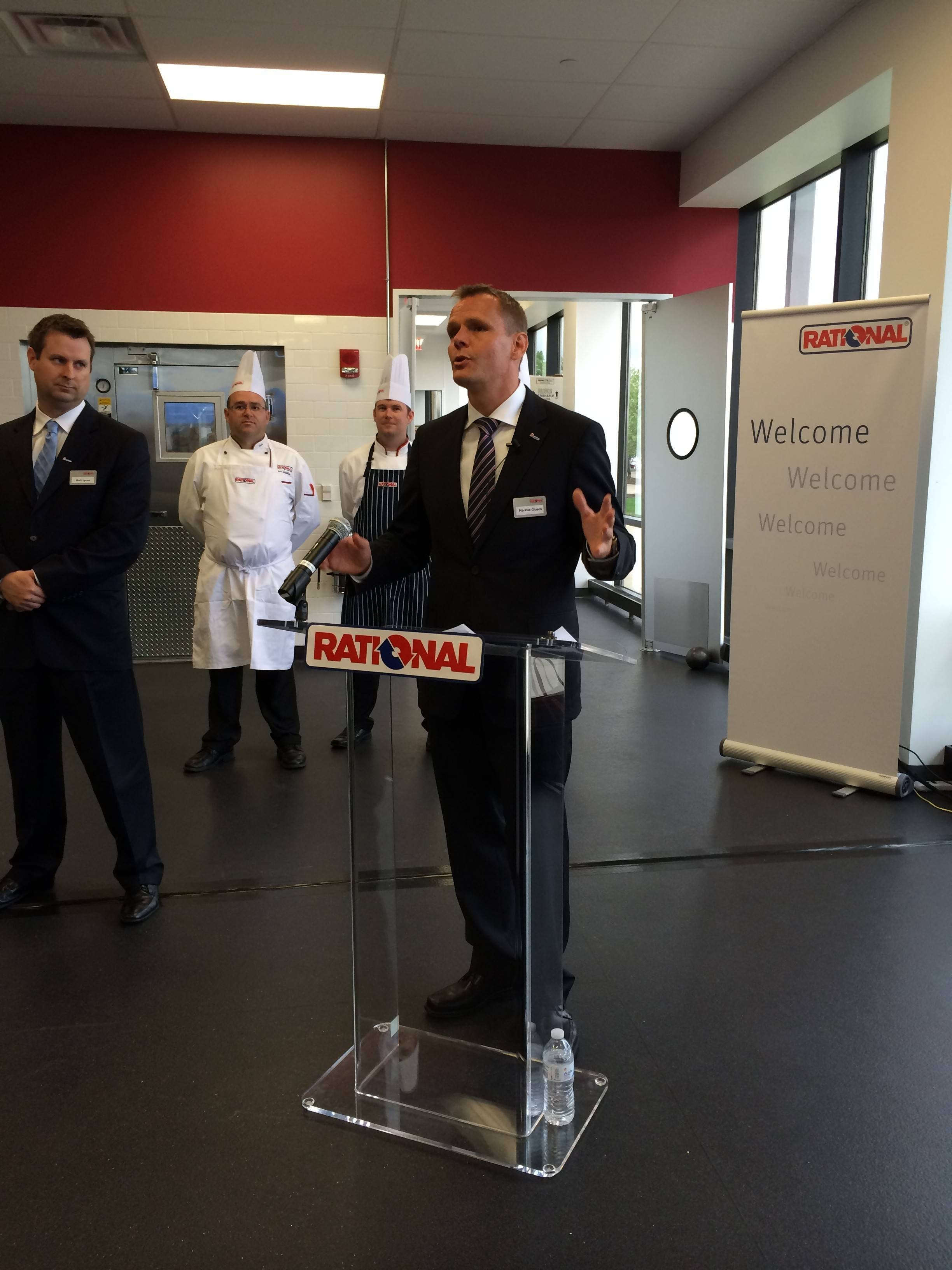 Rational USA President Markus Glueck addresses about 100 local business, chamber and village officials who welcomed the company's North American headquarters to Rolling Meadows on Thursday.