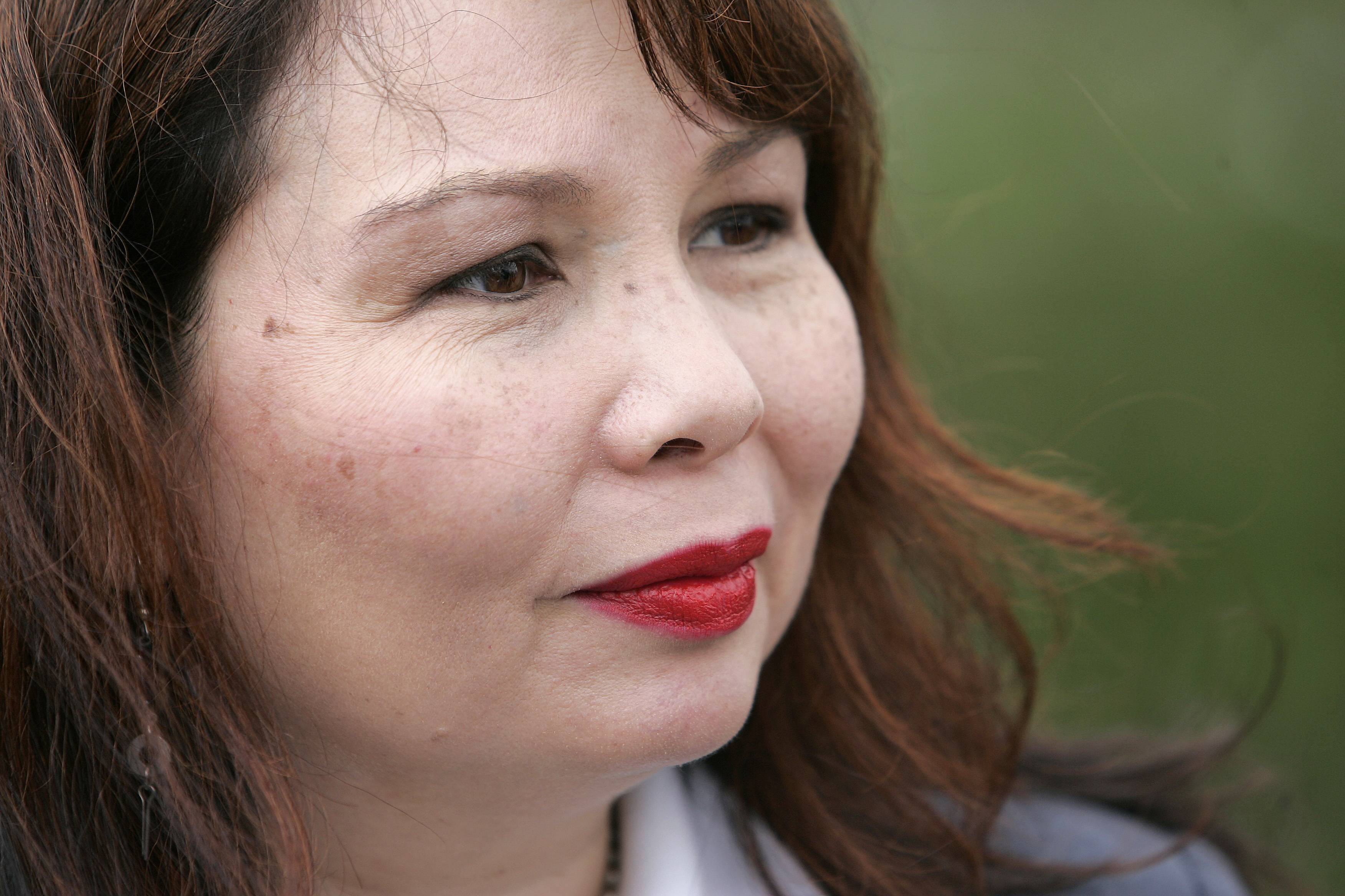 U.S. Rep. Tammy Duckworth talks Thursday about the need to replace a bridge that carries the Milwaukee West Line over the Fox River in Elgin. Metra has applied for $17 million in federal funding to help replace the single-track bridge.