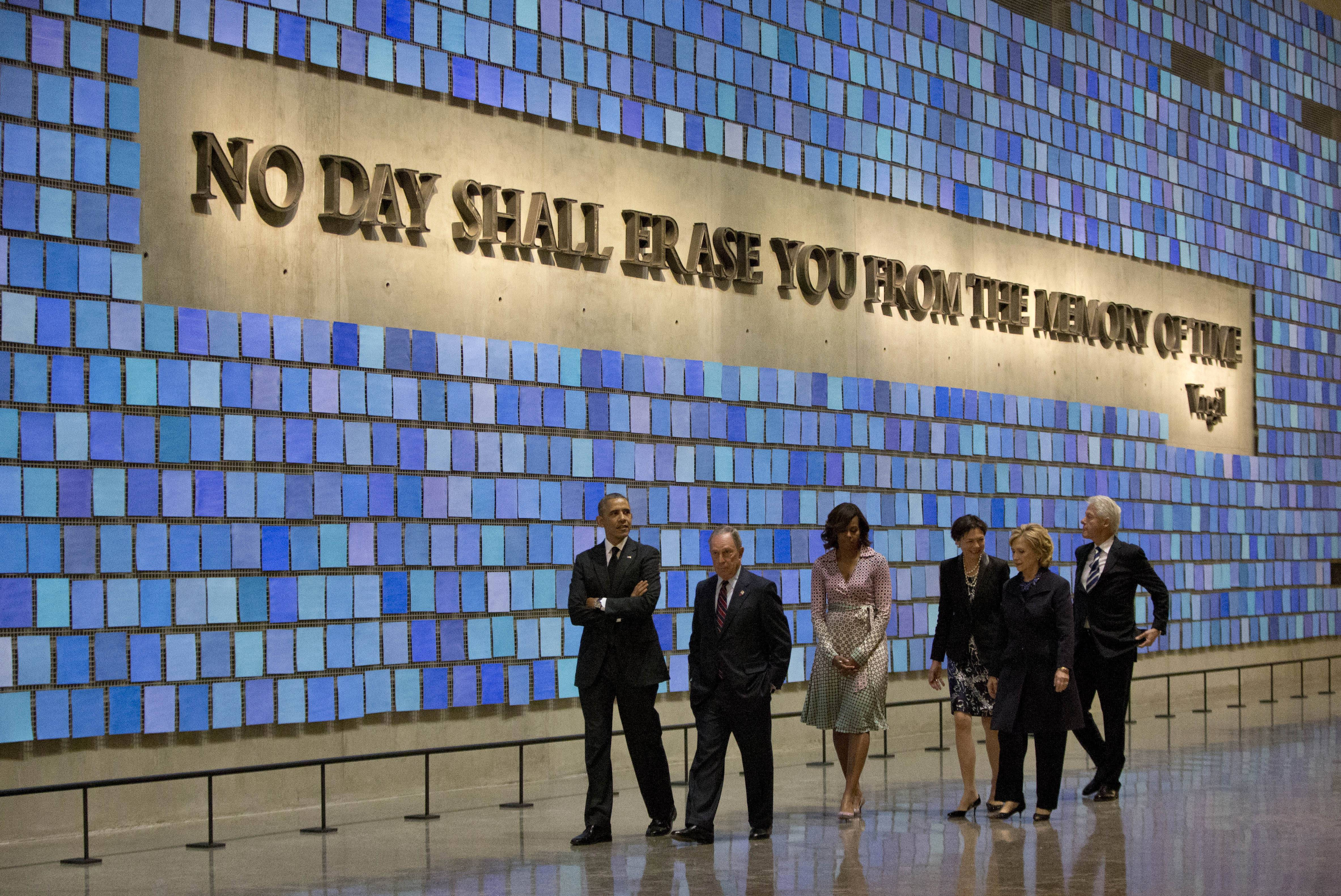 President Barack Obama, first lady Michelle Obama, former New York City Mayor Michael Bloomberg, former Secretary of State Hillary Rodham Clinton, former President Bill Clinton, and Diana Taylor, tour the Memorial Hall at the National September 11 Memorial Museum Thursday in New York.
