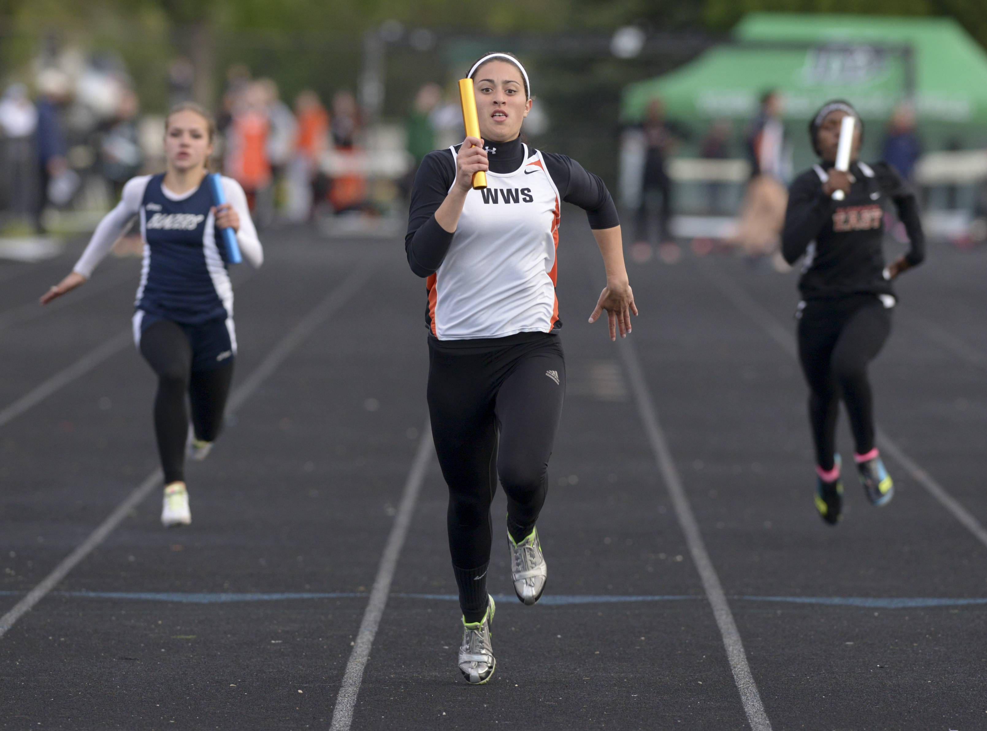 Maggie Dansdill of Wheaton Warrenville South runs the 400 m relay during the Wheaton Warrenville South girls track sectional.