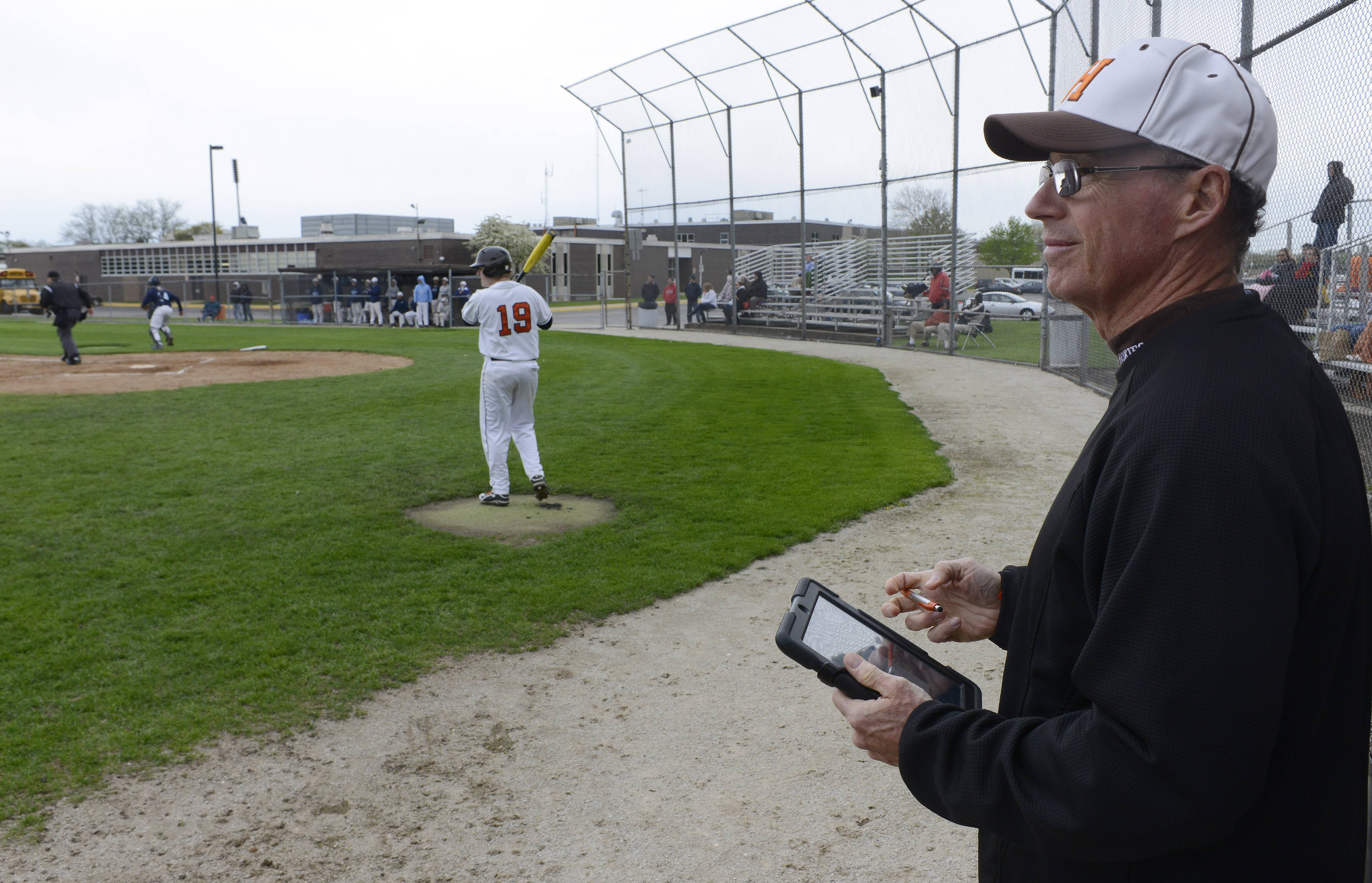 Hersey assistant baseball coach Kevin Kelley keeps score the newfangled way.