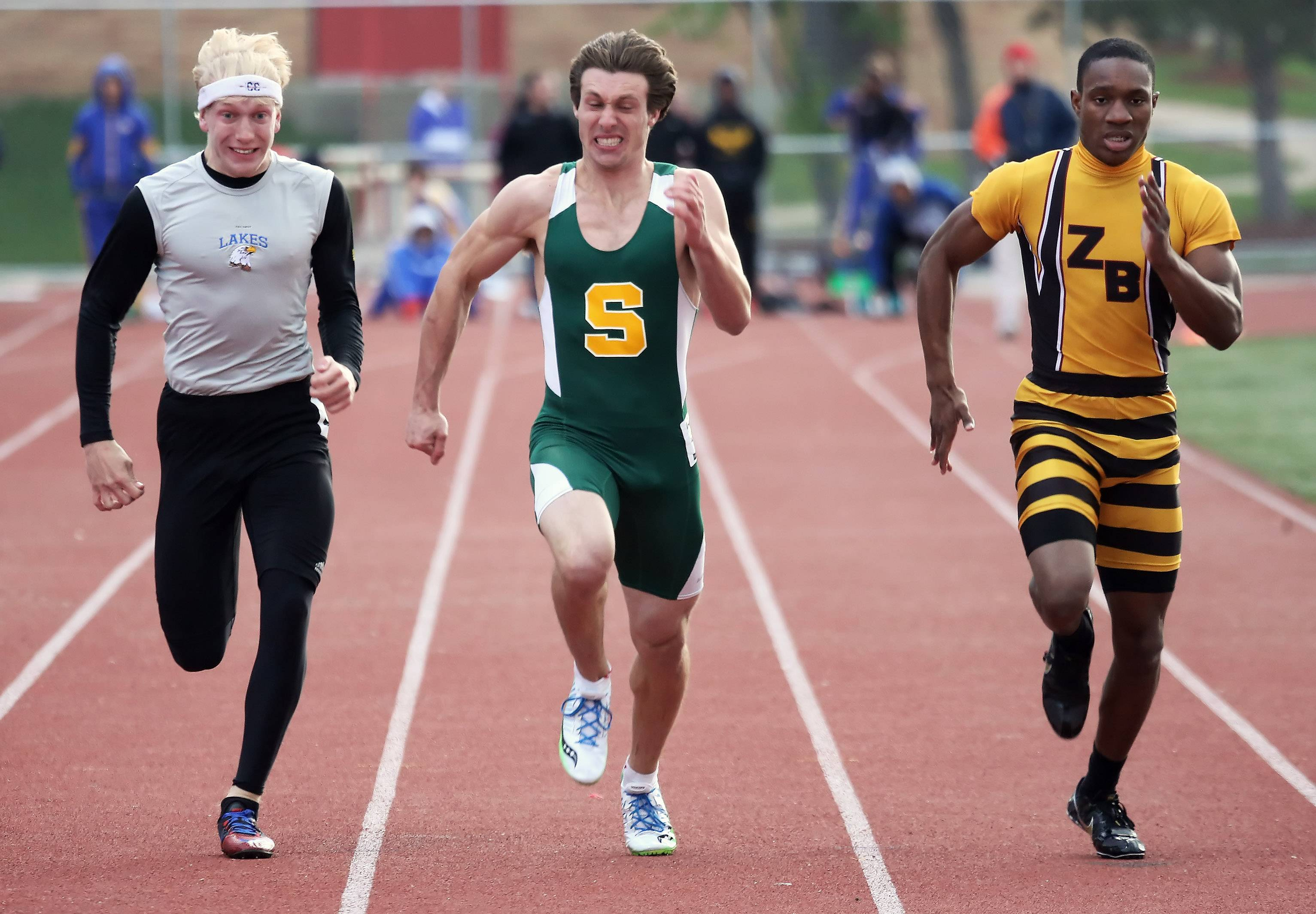 Lakes' Corey Hertz, Stevenson's Tim Vestuto and Zio-Benton's Jon Roberts are neck and neck in the 100-meter dash during the North Suburban Conference meet Thursday at Mundelein.