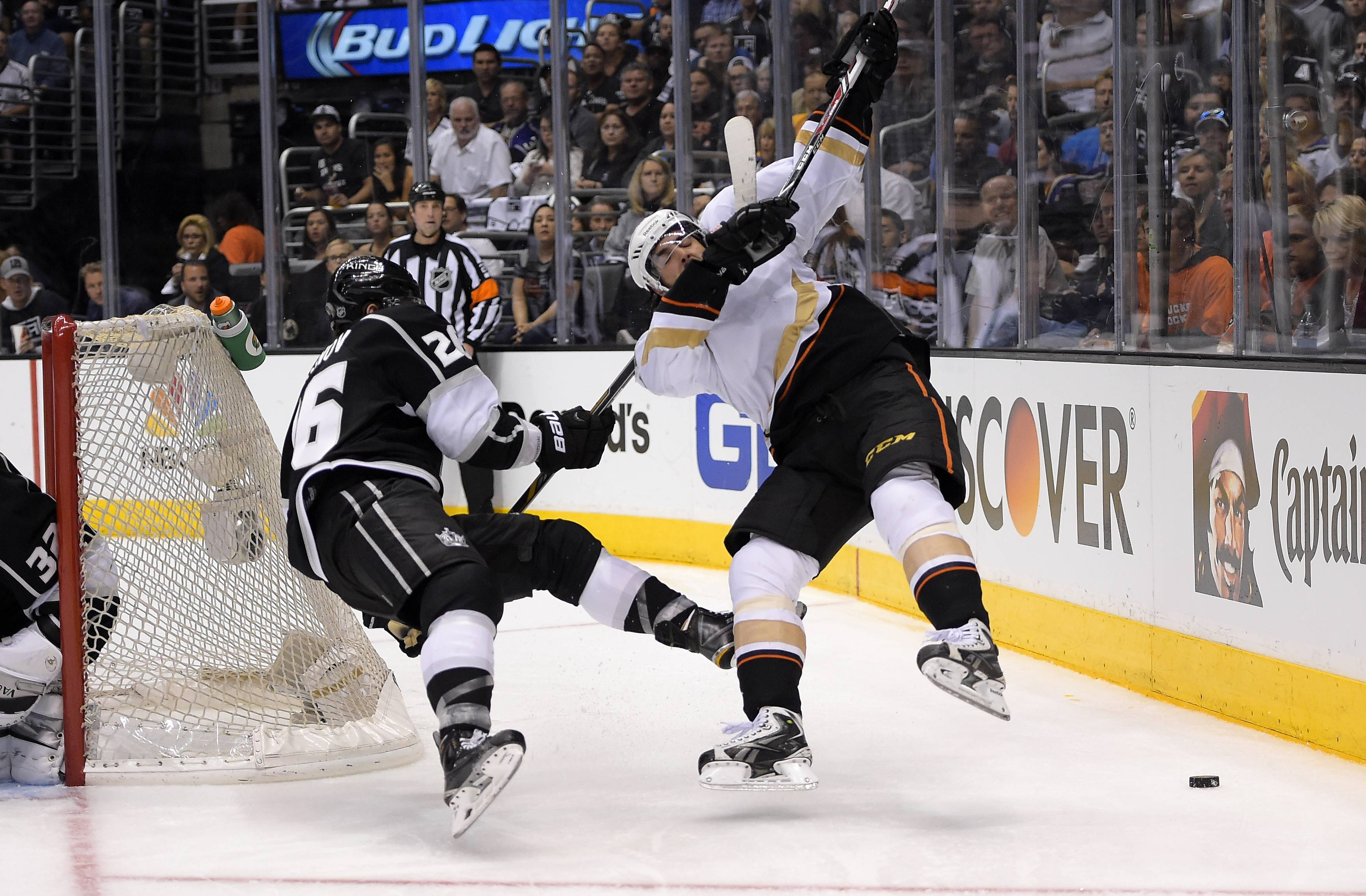 Los Angeles Kings defenseman Slava Voynov, left, of Russia, pulls down Anaheim Ducks center Mathieu Perreault during the third period in Game 6 of an NHL hockey second-round Stanley Cup playoff series, Wednesday. Both teams know the action will be fast and furious in tonight's Game 7as it's win or go home.