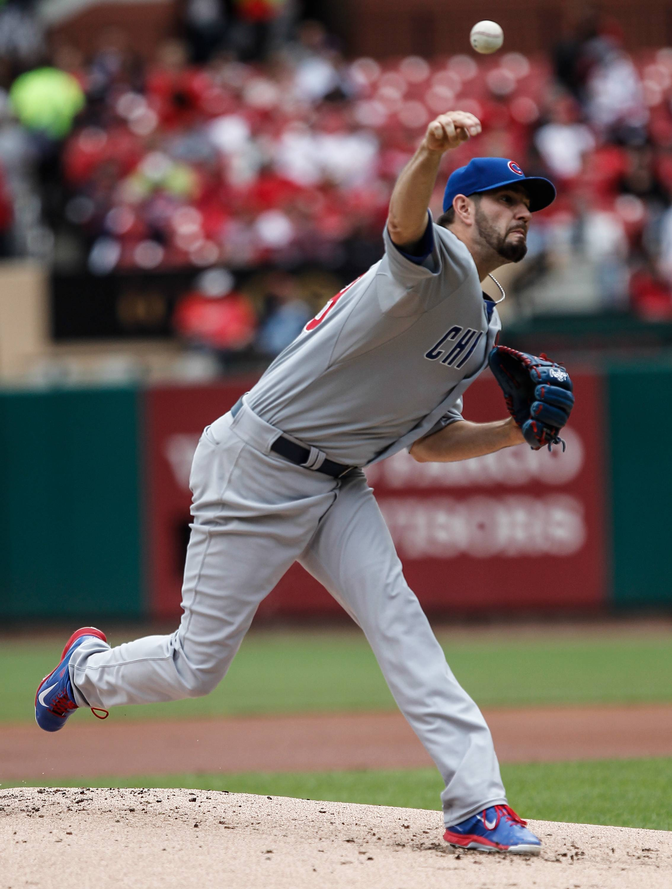 Associated Press Cubs starting pitcher Jason Hammel delivers a pitch to a St. Louis Cardinals batter during the first inning of a baseball game Thursday in St. Louis.