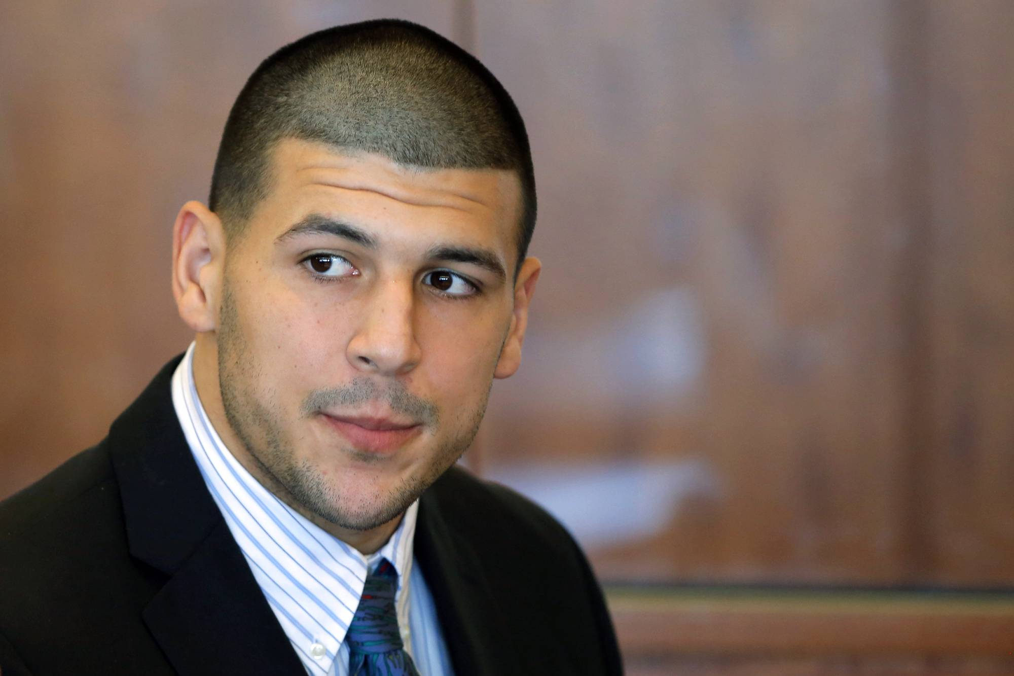 Former New England Patriots NFL football player Aaron Hernandez, who already faces a murder charge in a man's shooting death last year, was indicted Thursday, May 15, 2014, on new murder charges in an unrelated 2012 double slaying in Boston, police said.