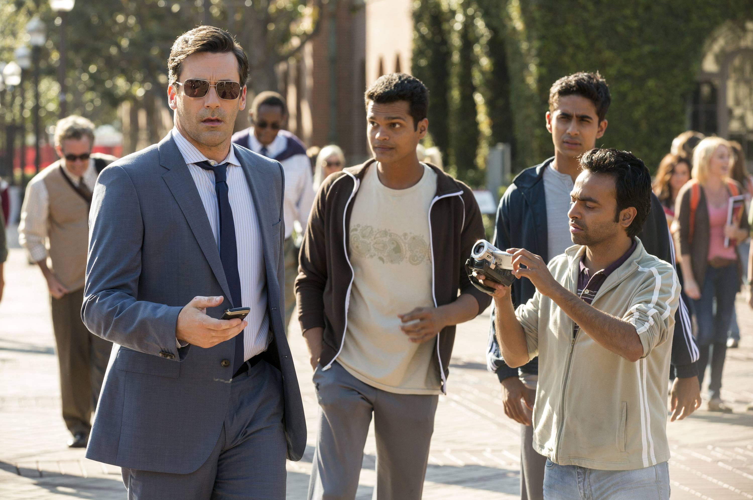 "A desperate sports agent (Jon Hamm), left, goes to India to find baseball talent with a translator (Pitobash), far right, and two recruits (Madhur Mittal and Suraj Sharma) in ""Million Dollar Arm."""