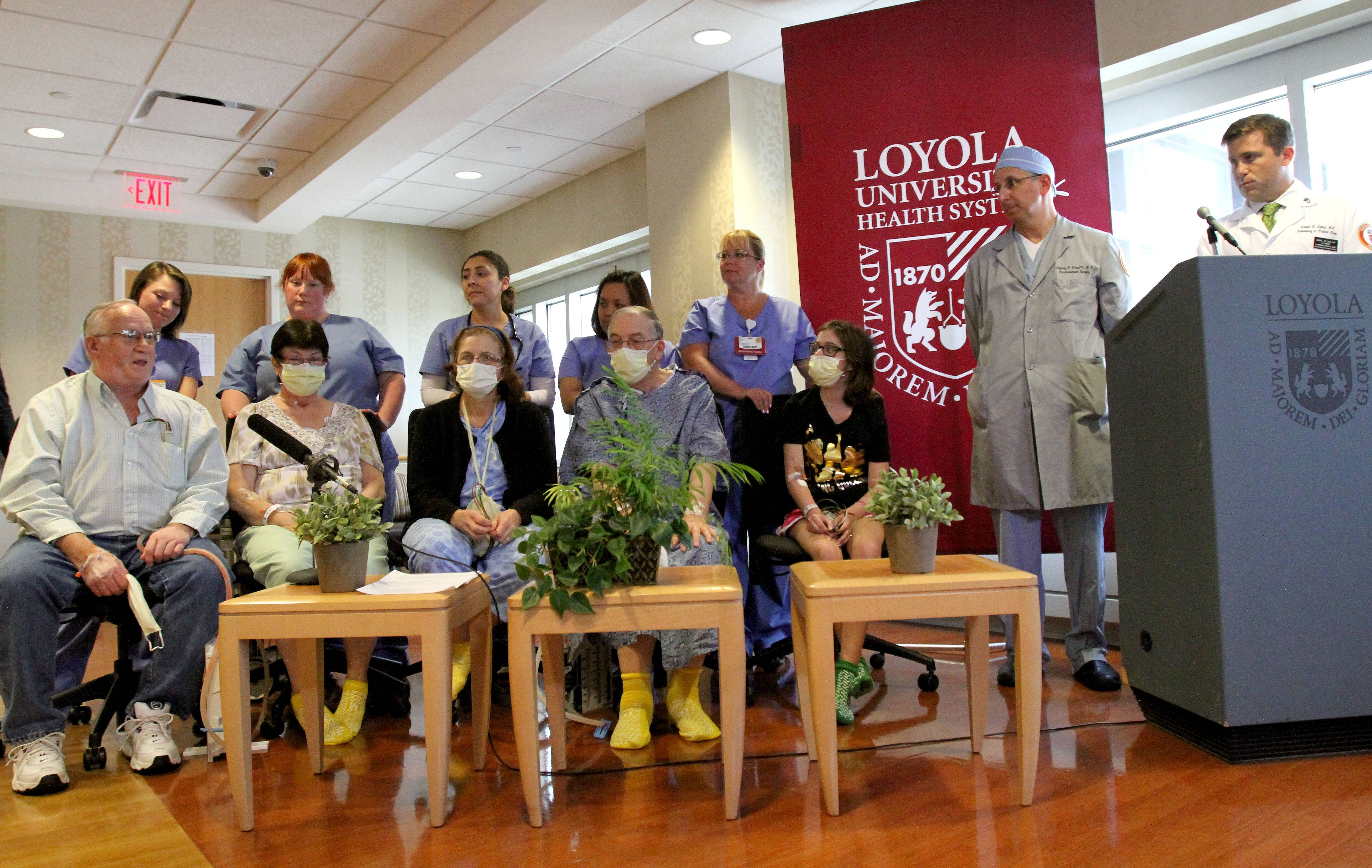 For the first time in Illinois, five successful lung transplants were performed in roughly 24 hours at Loyola University Medical Center in Maywood. The recipients, from left, are Roderick Beck of Springfield; Linda Kern of Princeton; Karen Emerich of New Carlisle, Indiana; Robert Senander of Winfield; and Julie D'Agostino, of Elmhurst. They're joined by doctors Jeffrey Schwartz and Daniel Dilling.