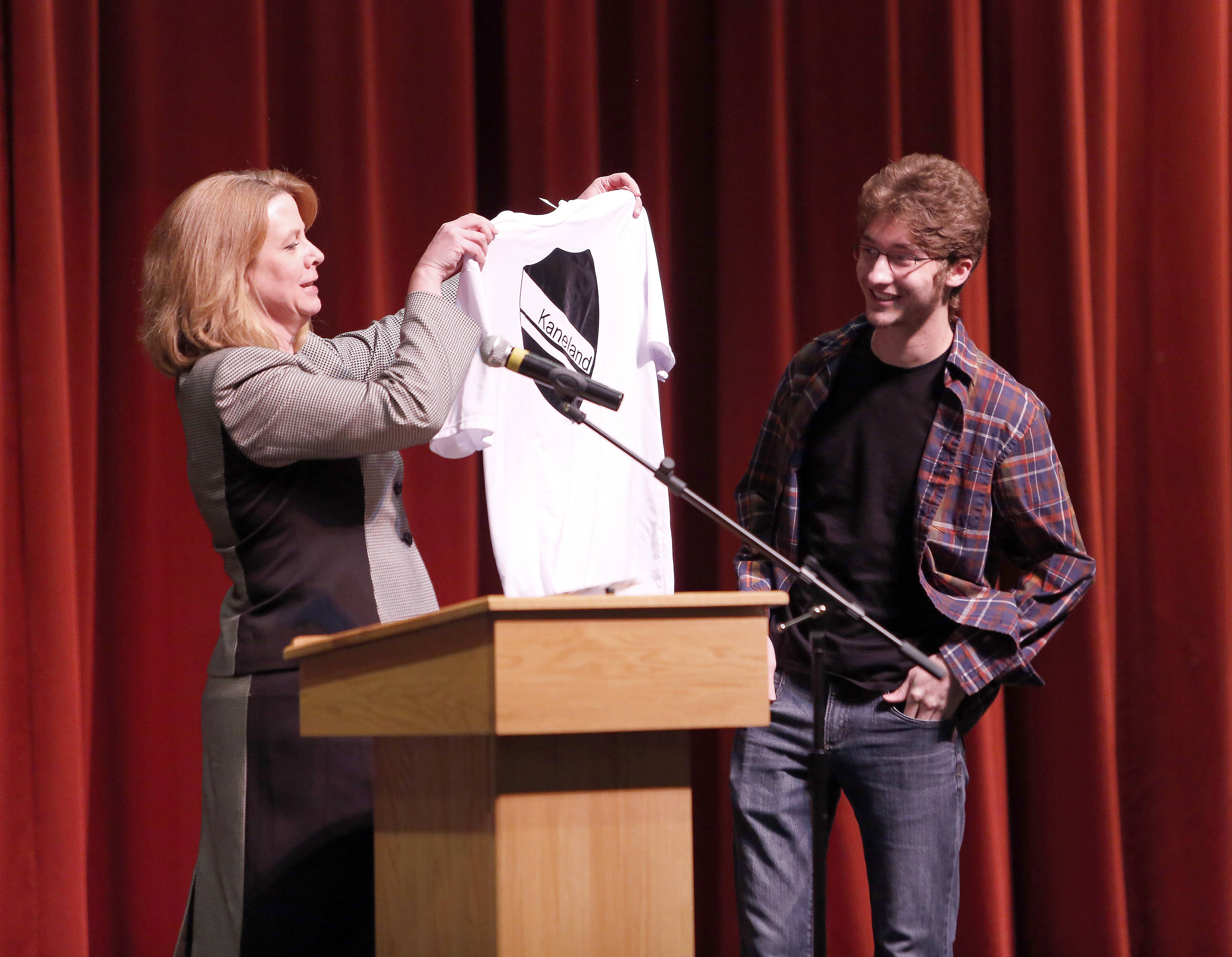 Kaneland High School Principal Jill Maras acknowledges senior Ethan Witt, who scored a perfect 36 on his ACT. The shirt has his name and score on the back, like a sports jersey.