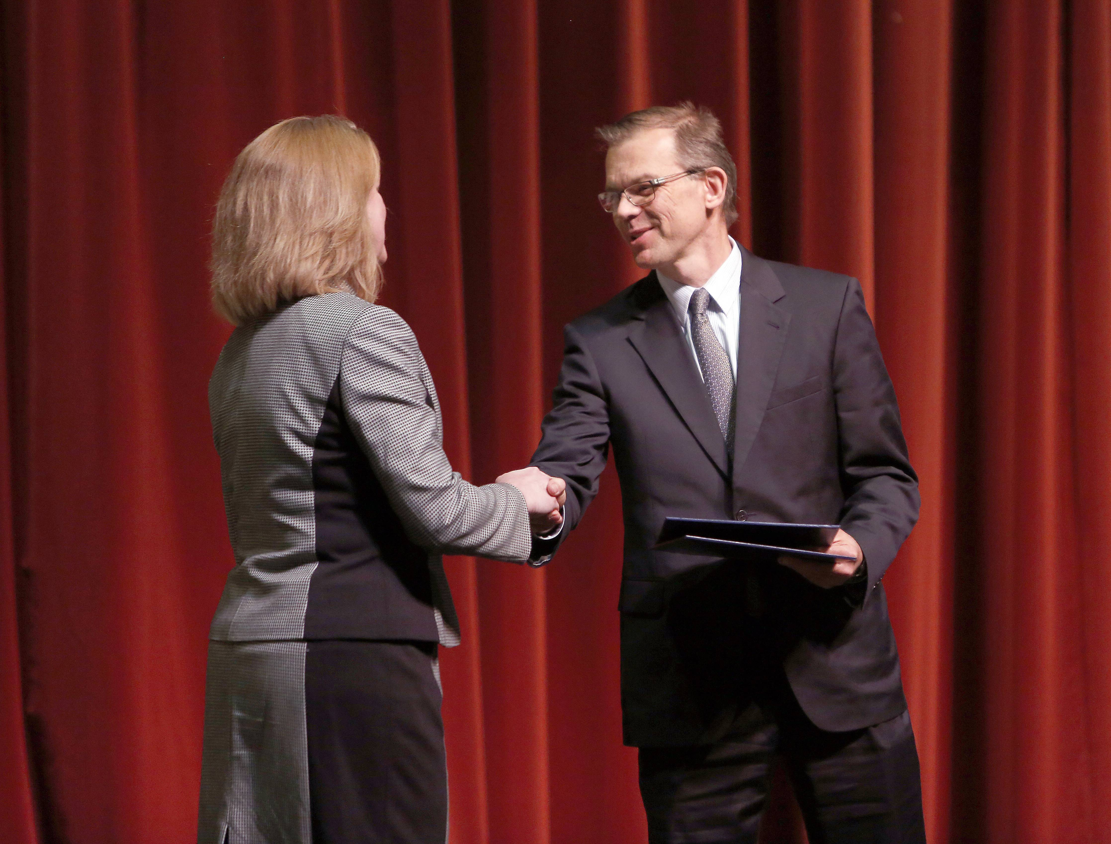 Kaneland High School Principal Jill Maras receives an award Thursday from Illinois state school Superintendent Christopher Koch. Nicholson Elementary School in Montgomery and Kaneland High School in Maple Park received Academic Improvement awards and are on the 2013 Illinois Honor Roll.