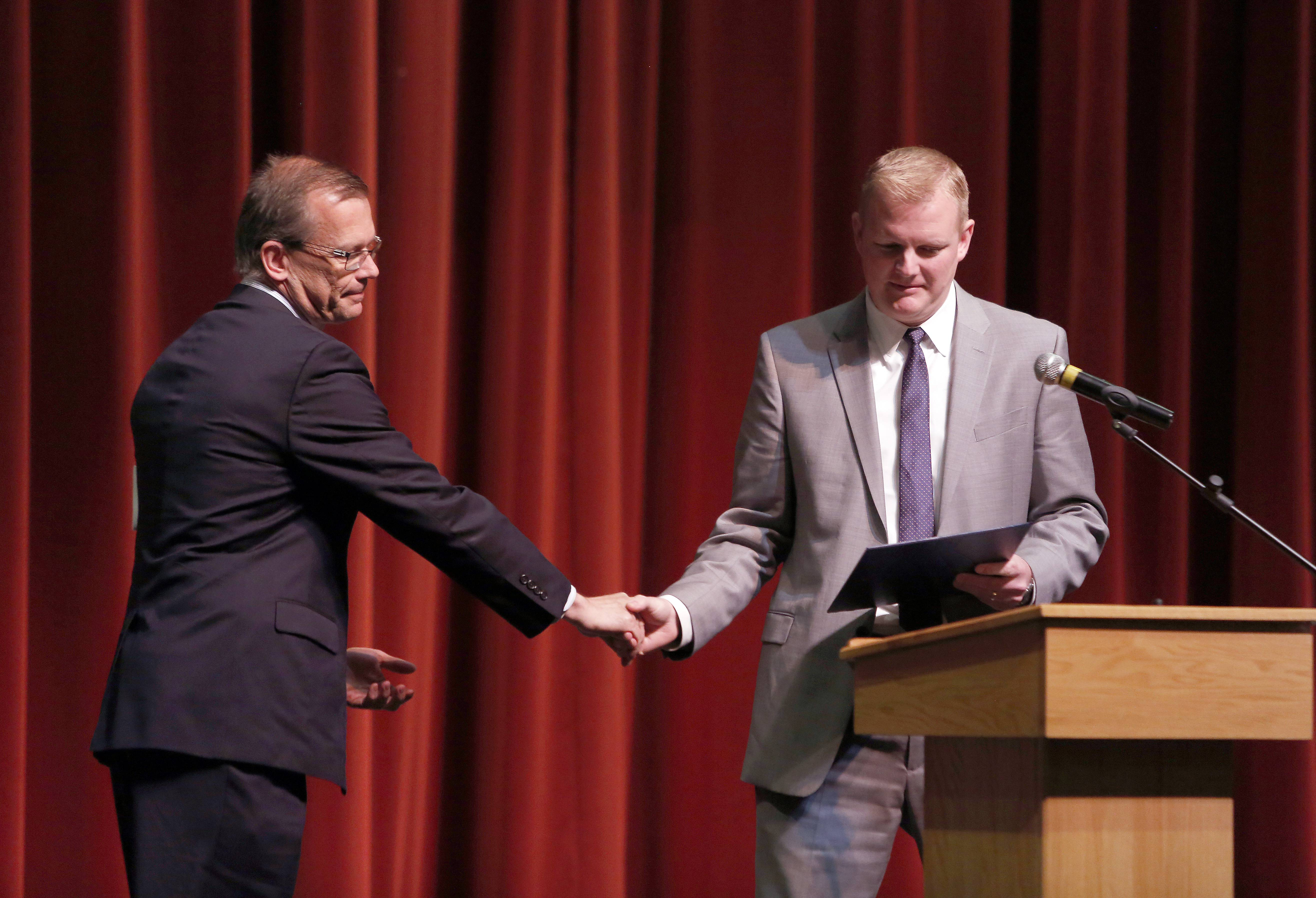 Illinois state schools Superintendent Christopher Koch, left, presented Nicholson Elementary School Principal Dave Russell with an Academic Improvement award Thursday.