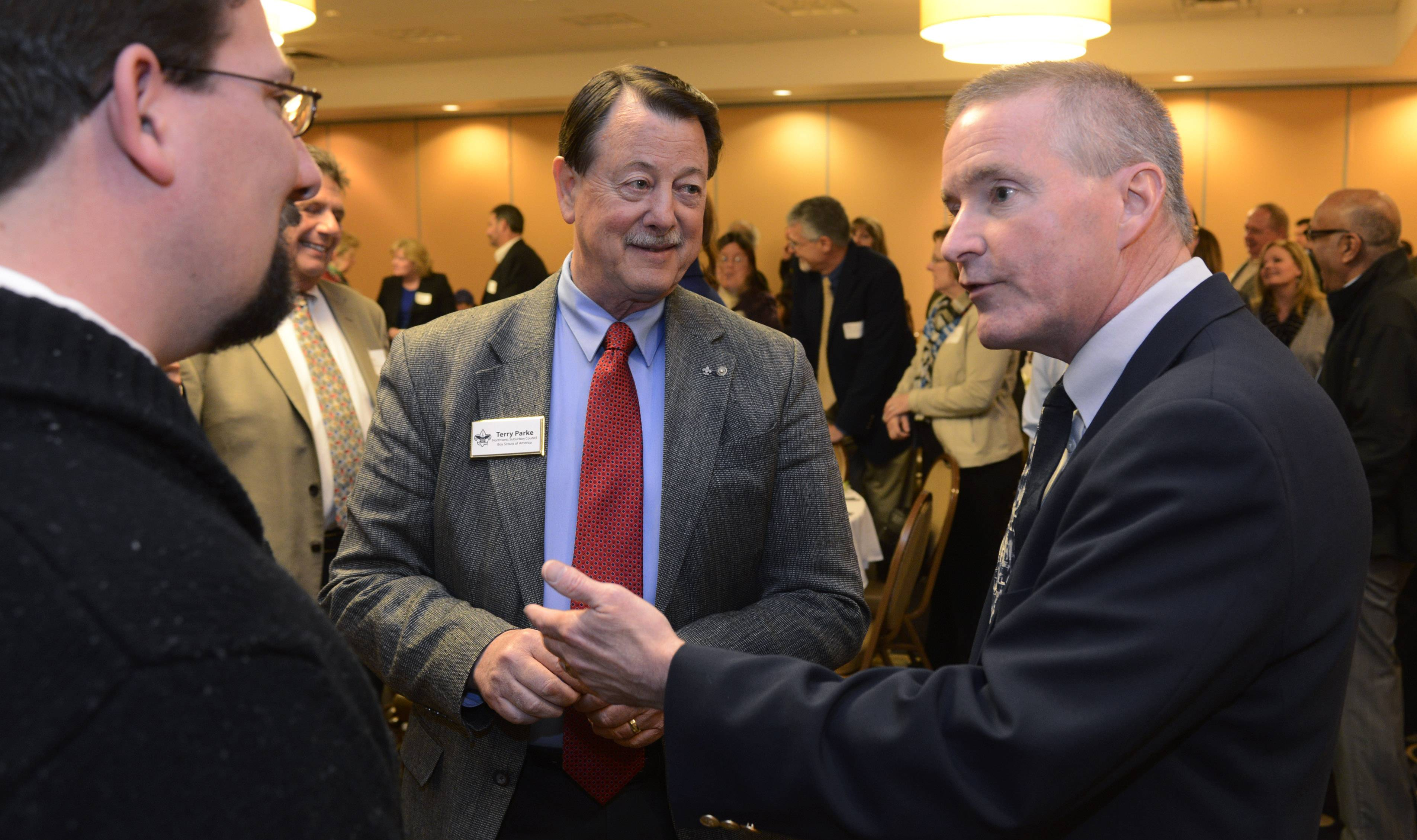 Elk Grove Village Mayor Craig Johnson, right, chats with Kevin Egan and Terry Parke of the Boy Scouts of America Northwest Suburban Council prior to delivering his state of the village address Thursday at an Elk Grove Chamber of Commerce luncheon.