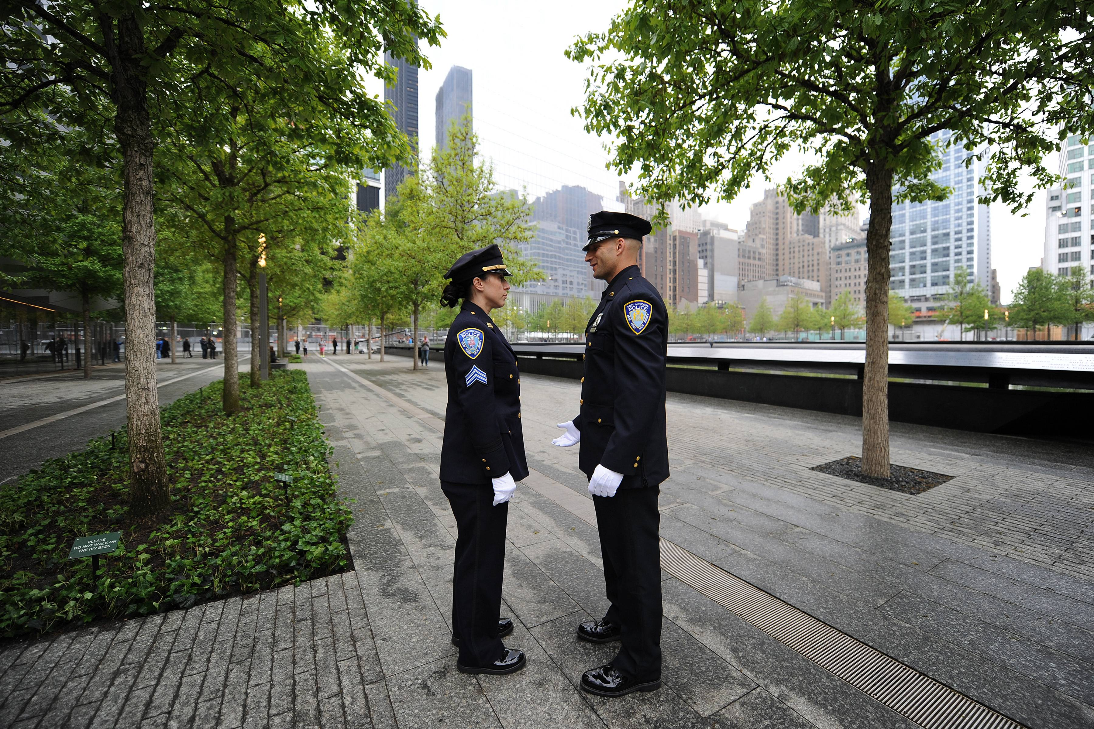 Two Port Authority Police Officers talk before the start of dedication ceremony at the National September 11 Memorial Museum .