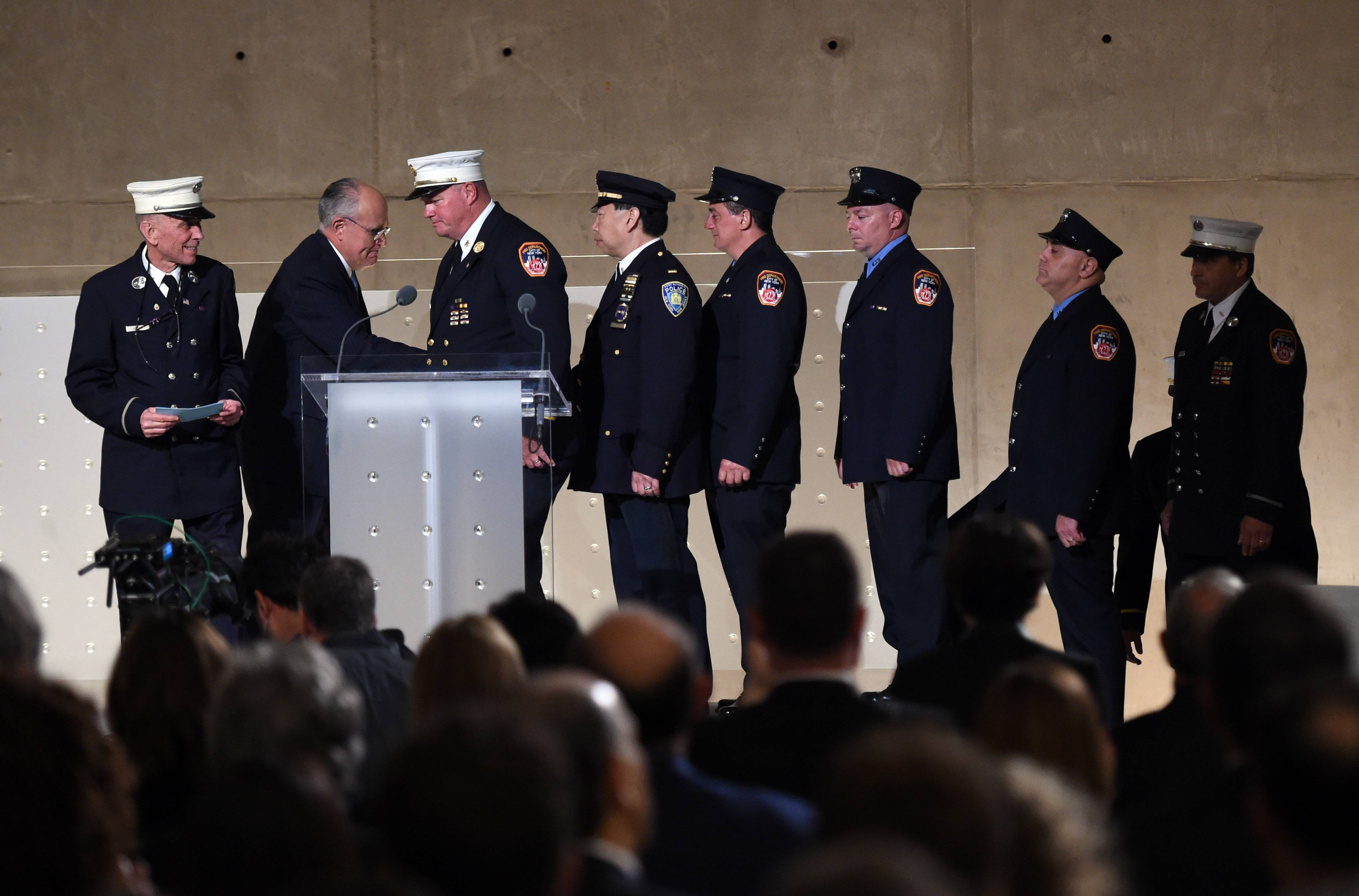 Former New York City Mayor Rudolph Giuliani greets New York City Fireman at the dedication.