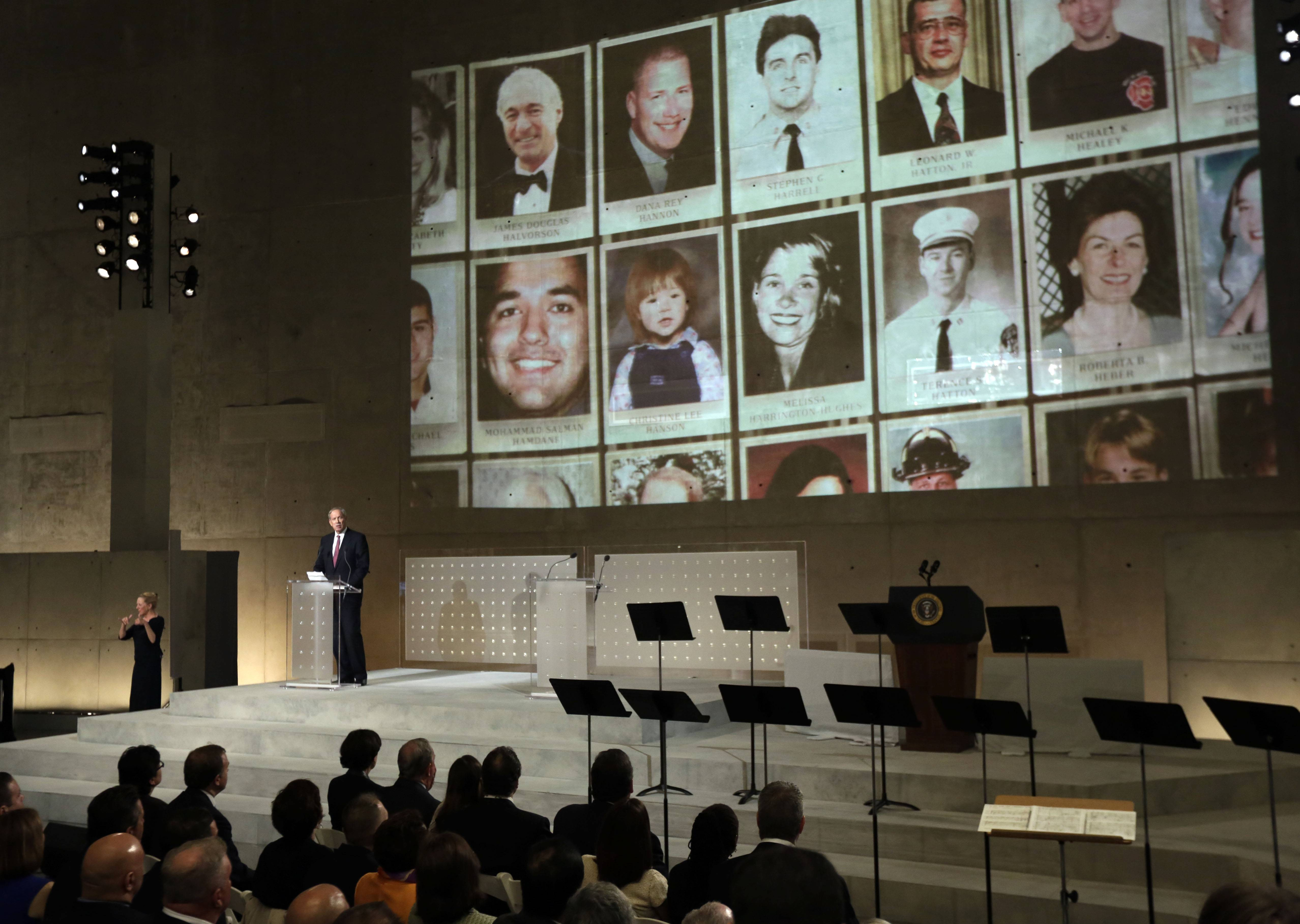 Former New York Gov. George Pataki speaks as photos of 9/11 victims are projected during the dedication ceremony.