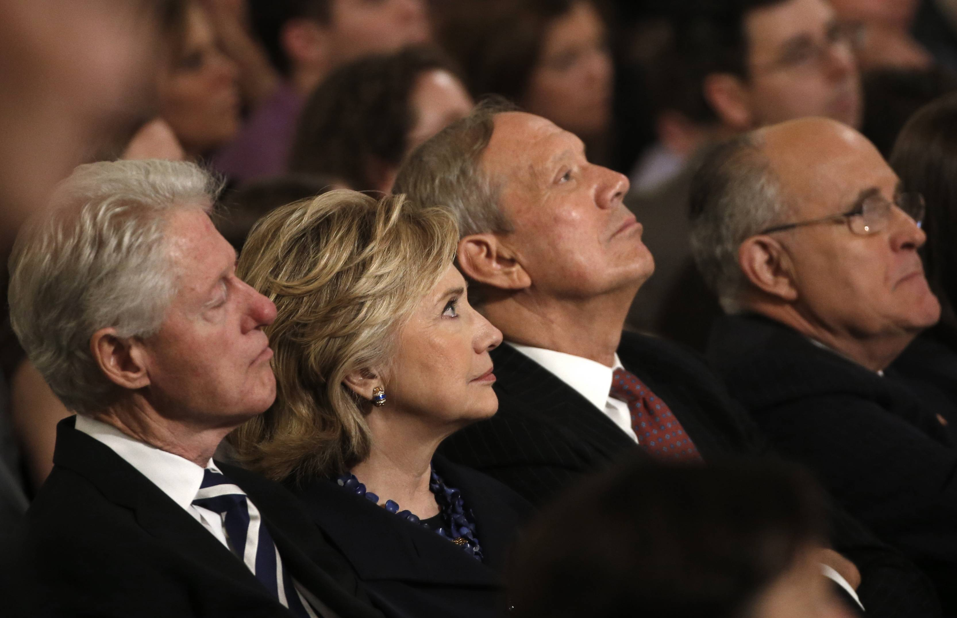 From left, Former U.S. President Bill Clinton sits with his wife former U.S. Secretary of State Hillary Clinton, former New York Governor George Pataki and former New York City Mayor Rudolph Giuliani during the dedication ceremony.