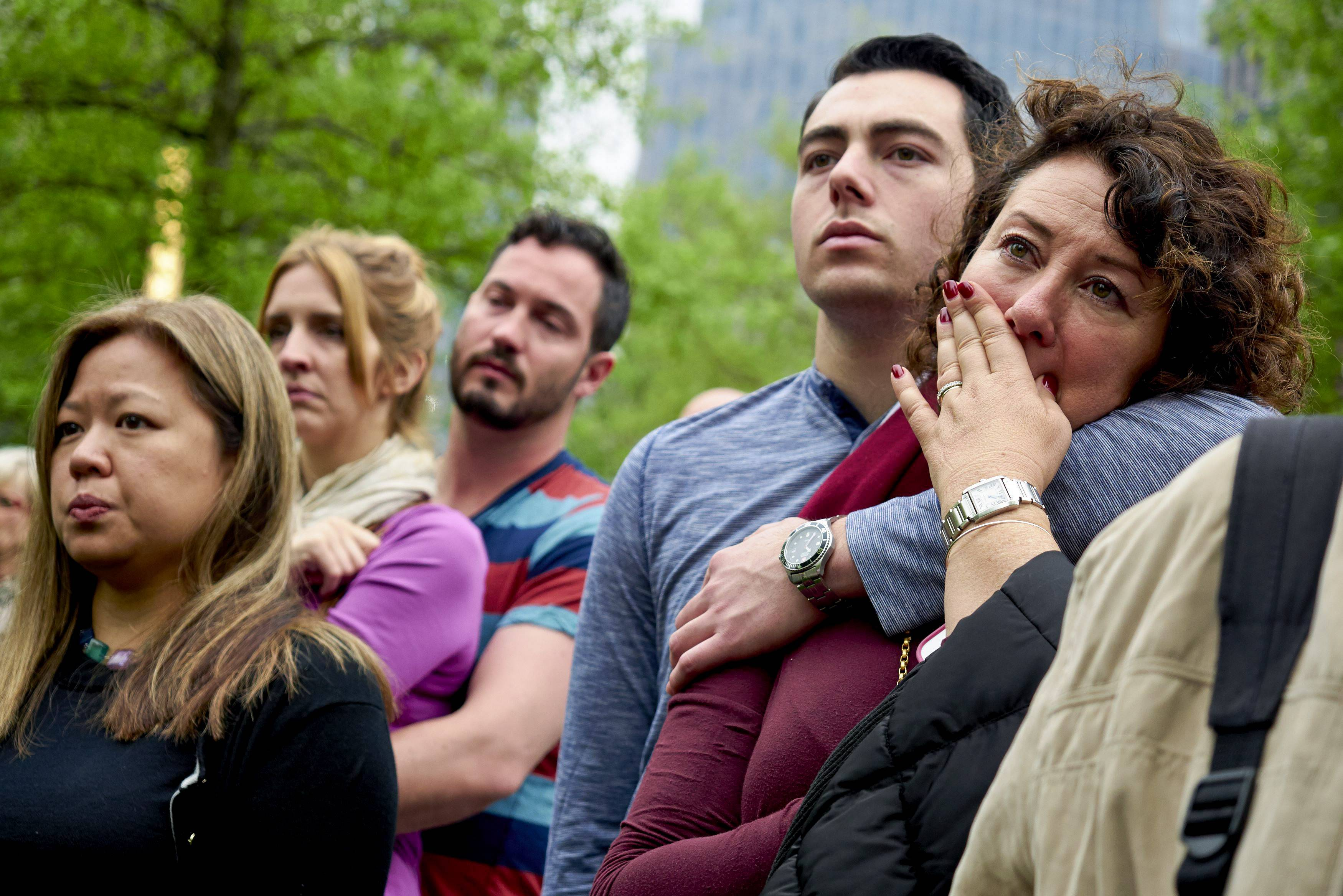 Visitors watch a screen projection of the dedication ceremony for the National September 11 Memorial Museum in New York, Thursday, May 15, 2014.
