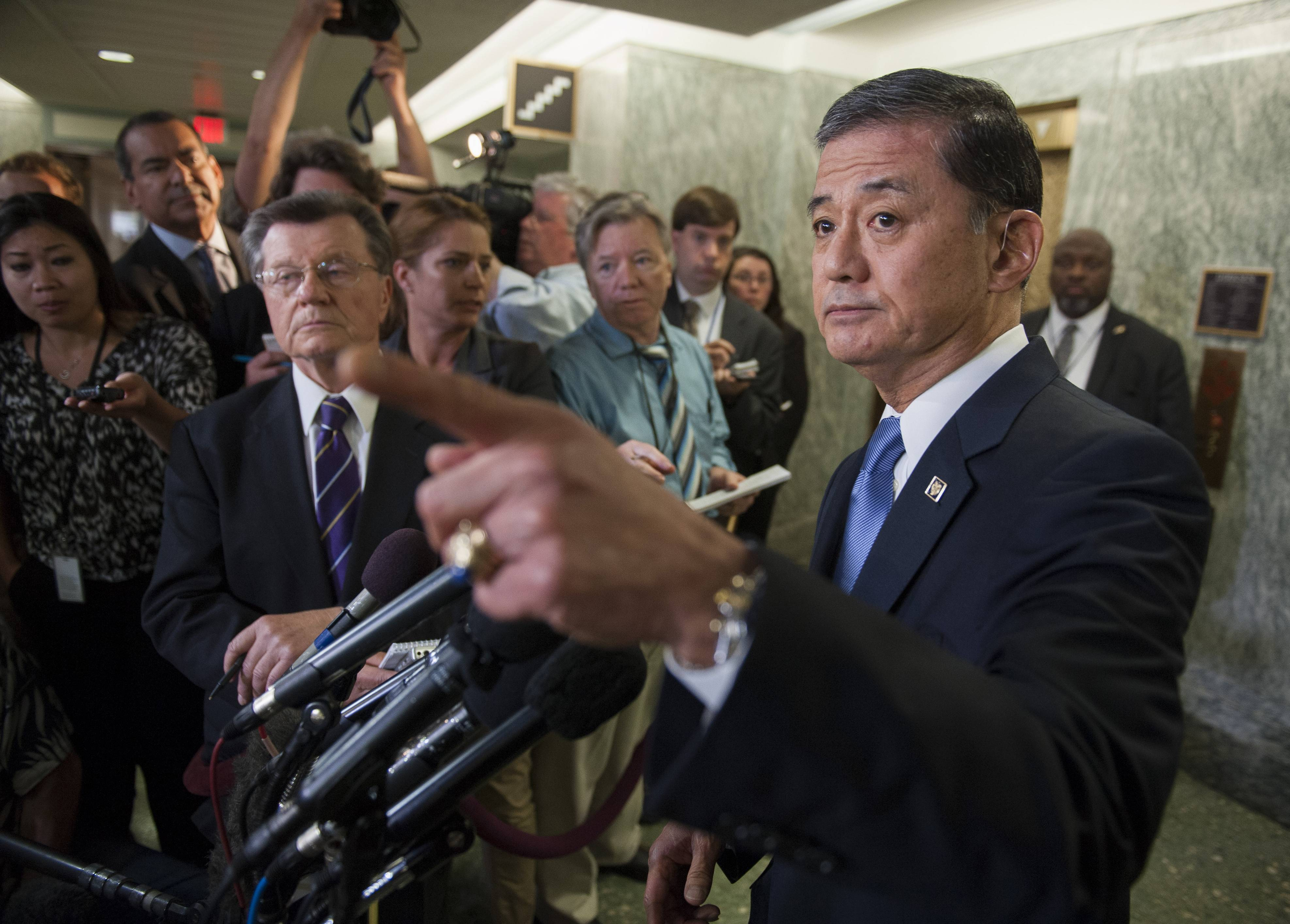 Veterans Affairs Secretary Eric Shinseki gestures during a news conference on Capitol Hill in Washington, Thursday after testifying before the Senate Veterans Affairs Committee hearing to examine the state of Veterans Affairs health care.
