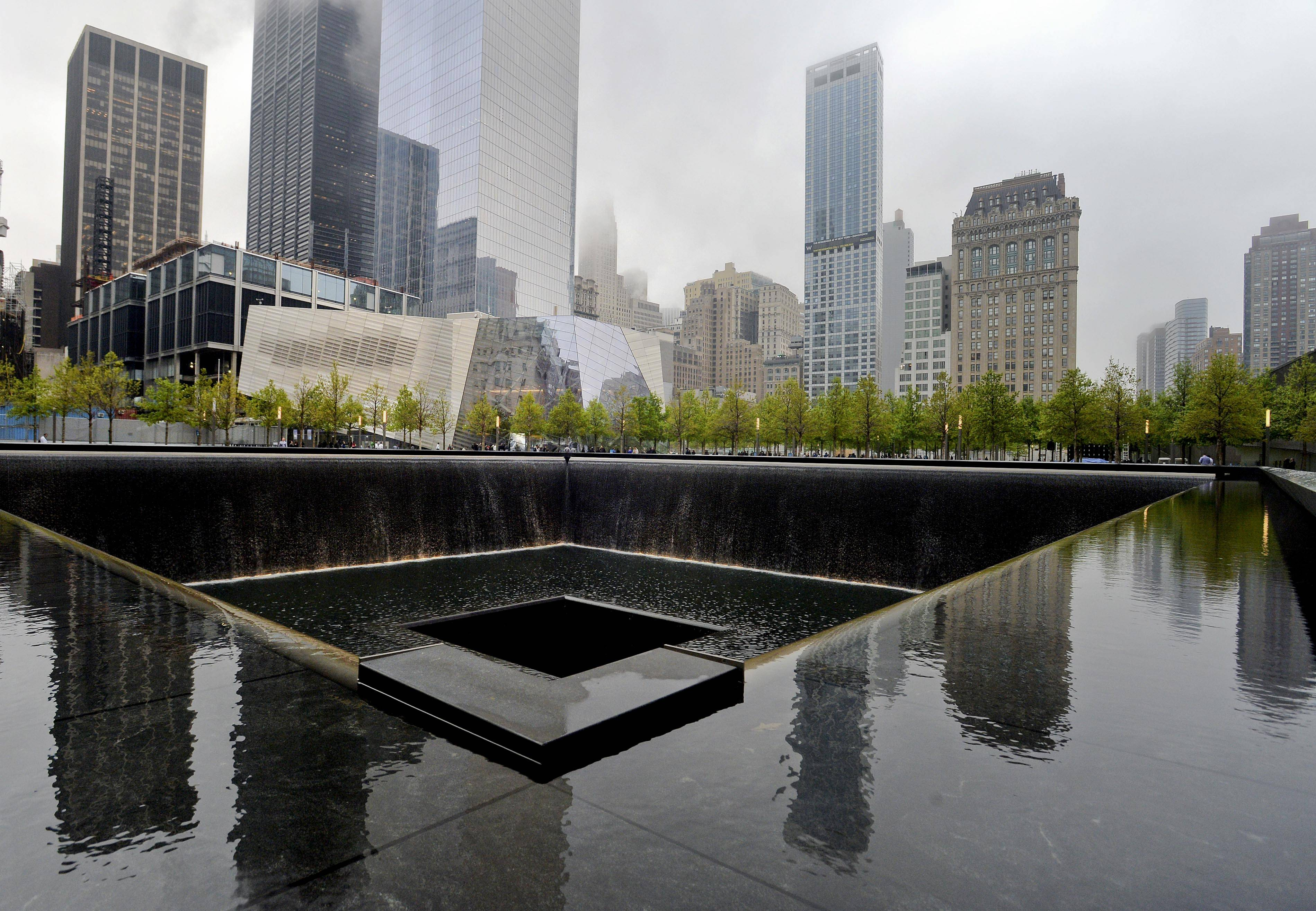 A view of the National September 11 Memorial Museum with the north reflecting pool in foreground during the museum's dedication ceremony in New York on Thursday.