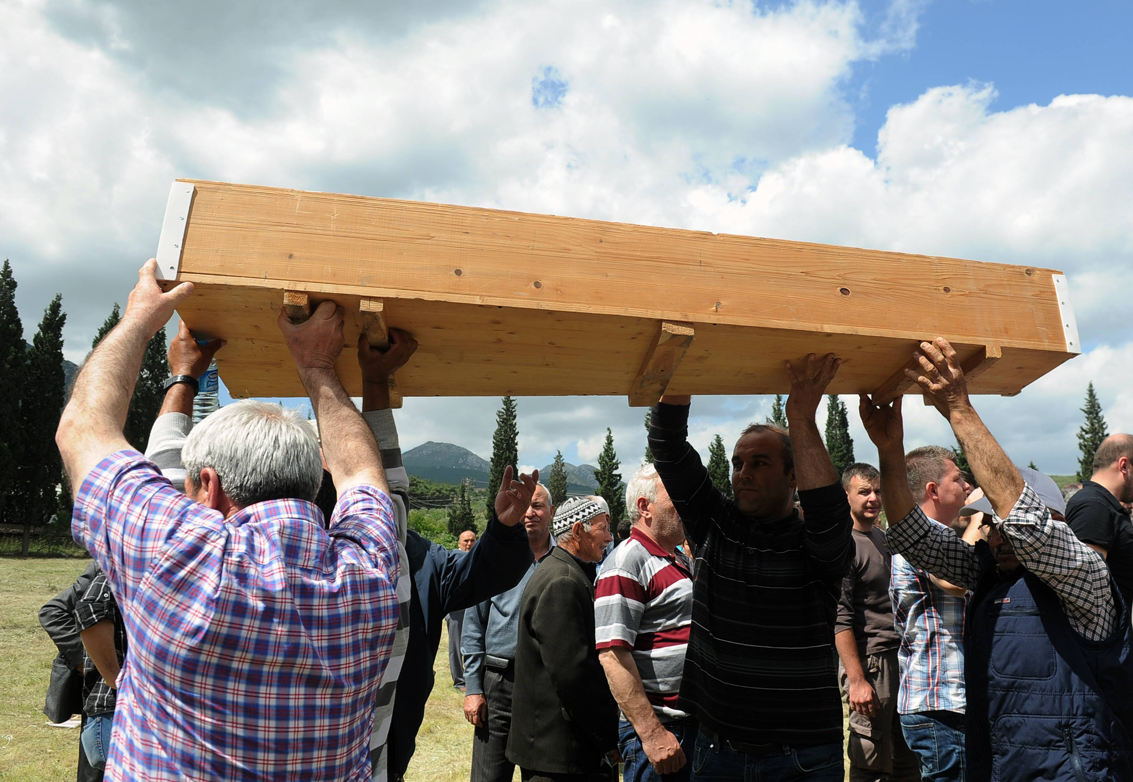 People carry the simple wooden coffin of a mine accident victim for burial in Soma, Turkey, Thursday. An explosion and fire at a coal mine in Soma, some 155 miles south of Istanbul, killed hundreds of workers, authorities said, in one of the worst mining disasters in Turkish history.