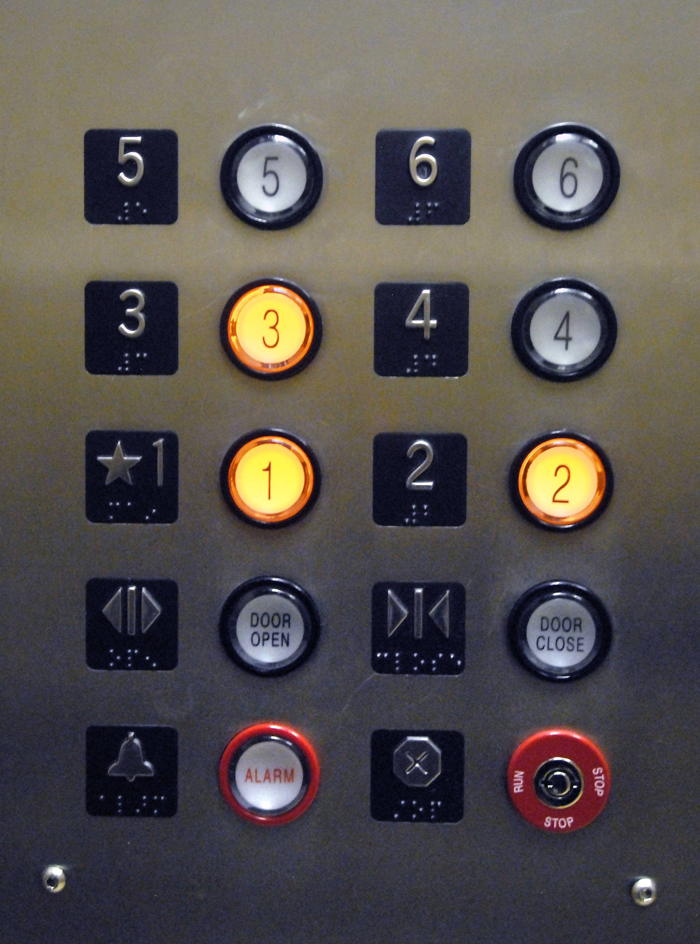 These simple buttons are a sign that you are standing in a place where anything can happen, and nothing usually does.