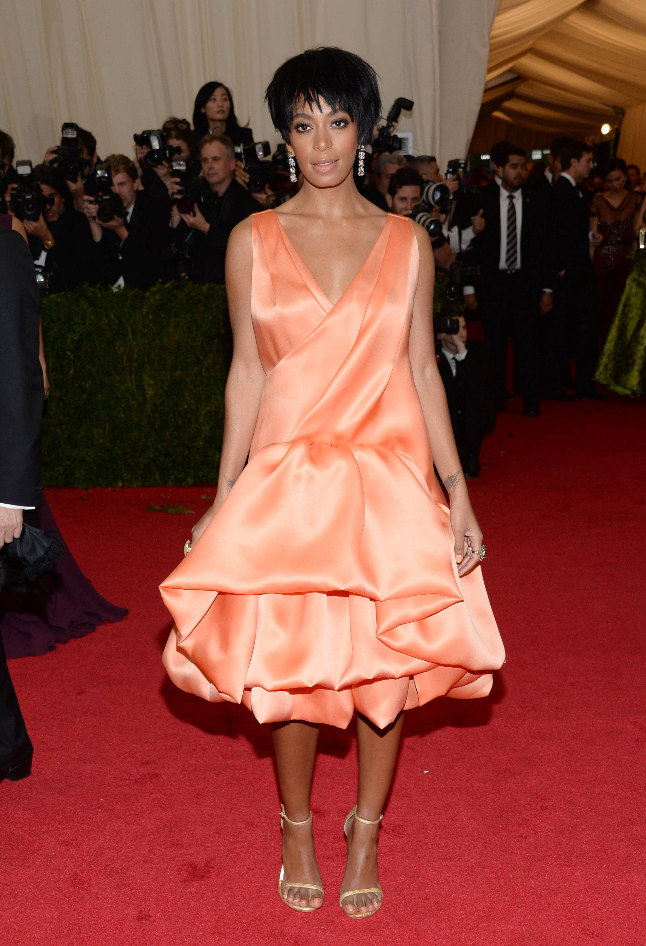 Looking cool in this photo from The Metropolitan Museum of Art's Costume Institute benefit gala in New York, Solange Knowles got more publicity from the elevator-surveillance video showing her slapping and kicking at her brother-in-law Jay Z.