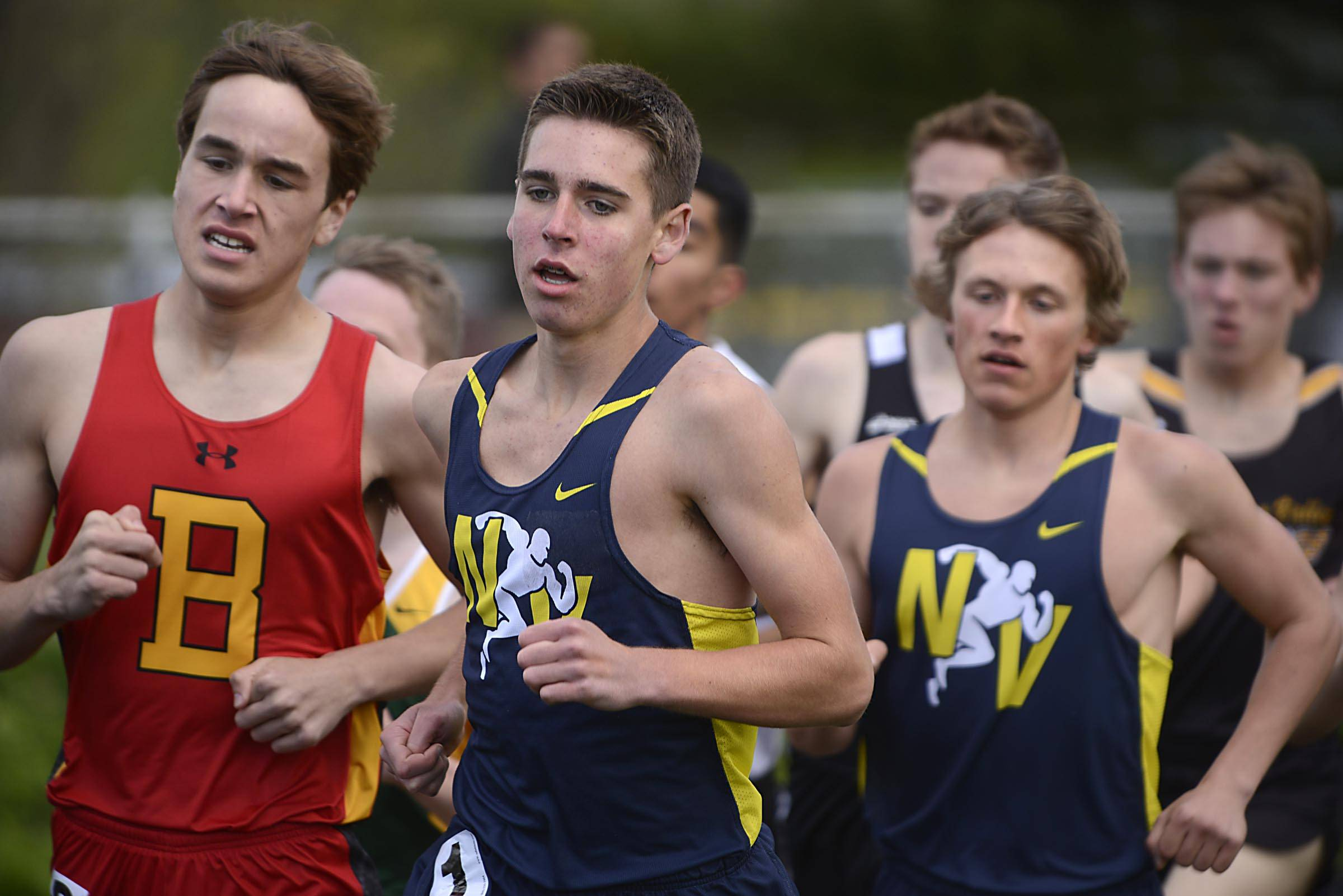 Neuqua Valley's Grayson Jenkins leads Batavia's David Morrison and teammate Daniel Weiss in the 3,200 meter run Thursday at the Upstate Eight Conference boys track meet at Memorial Field at Elgin High School. Jenkins won while Morrison placed second and Weiss ended in fourth place.