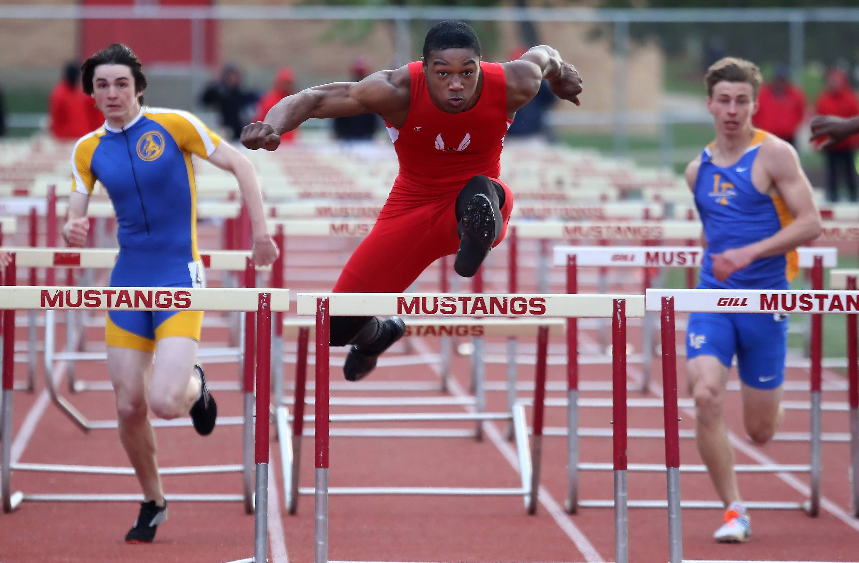Grant's Jonathan Wells wins the 110-meter hurdles during the North Suburban Conference meet Thursday at Mundelein.