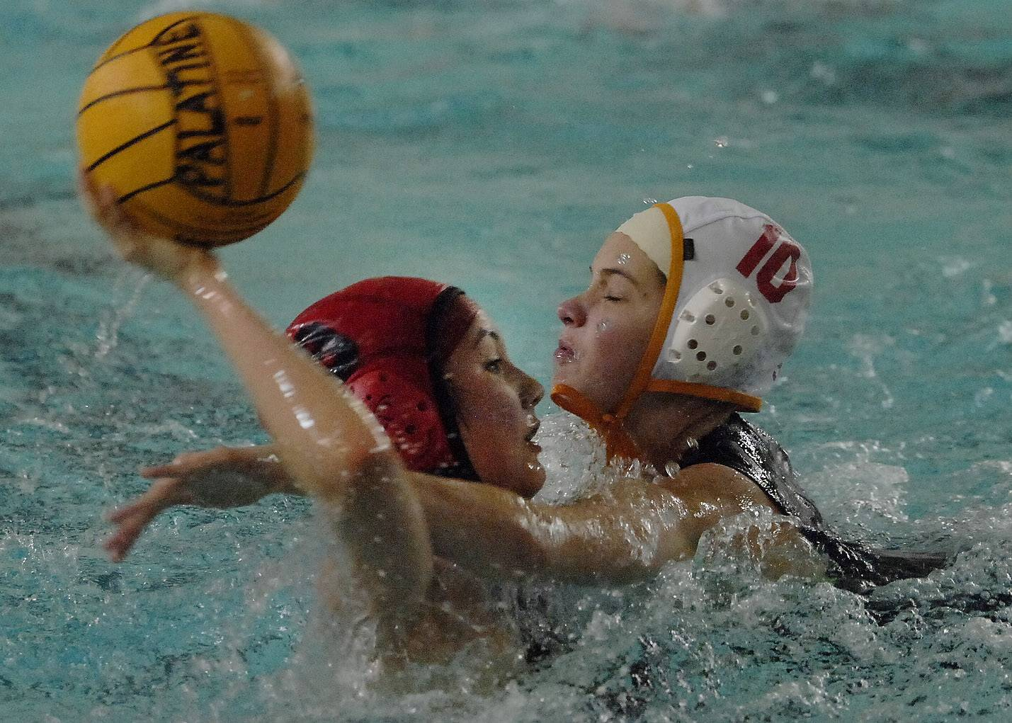 Barrington's Willa Wu attempts a shot on Becca Kasner of Schaumburg on Thursday at Palatine.