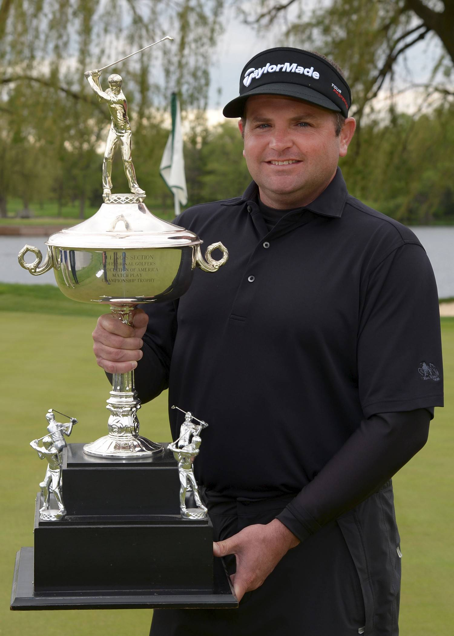 Curtis Malm, with the Illinois PGA Match Play Championship trophy.