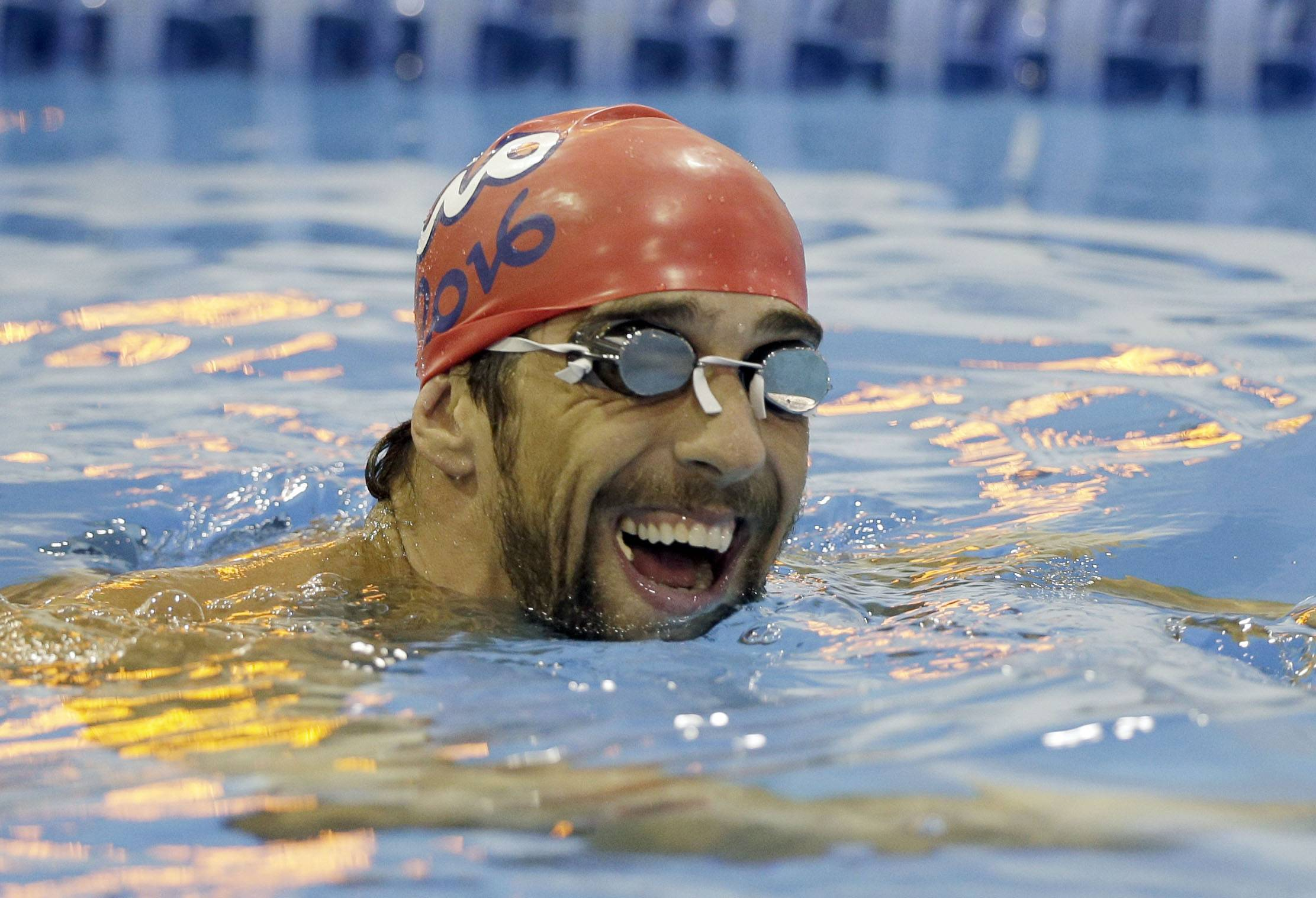 Michael Phelps warms up Thursday before the upcoming Charlotte Grand Prix swimming event in Charlotte, N.C..